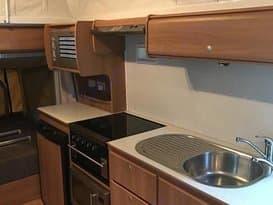 Interior showing kitchenette, fridge, A/C. Jayco Expanda 2010