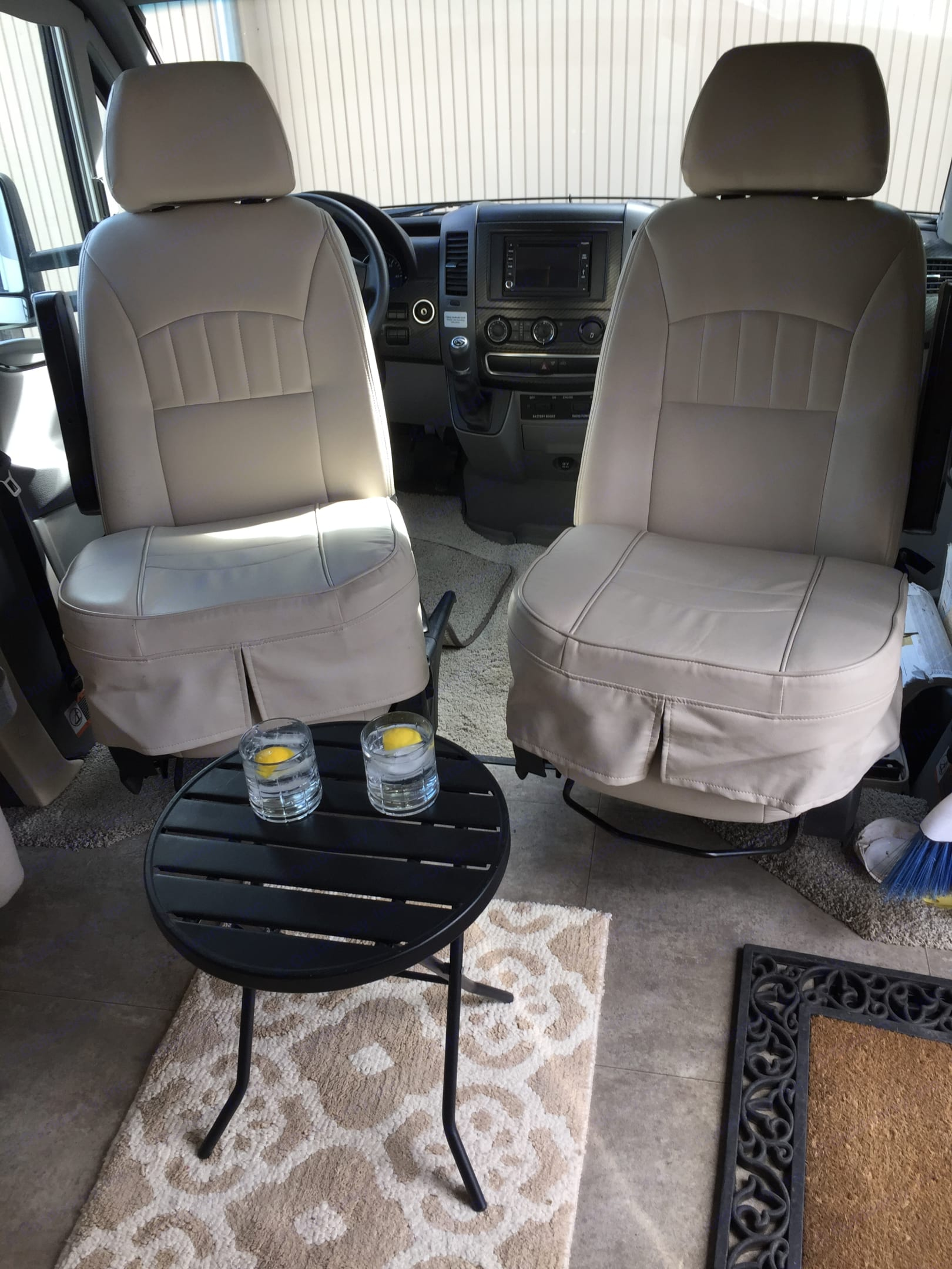 """""""In port"""", comfy swivel driver and passenger seats with seat-lounge cushions.. Winnebago View 24V 2015"""