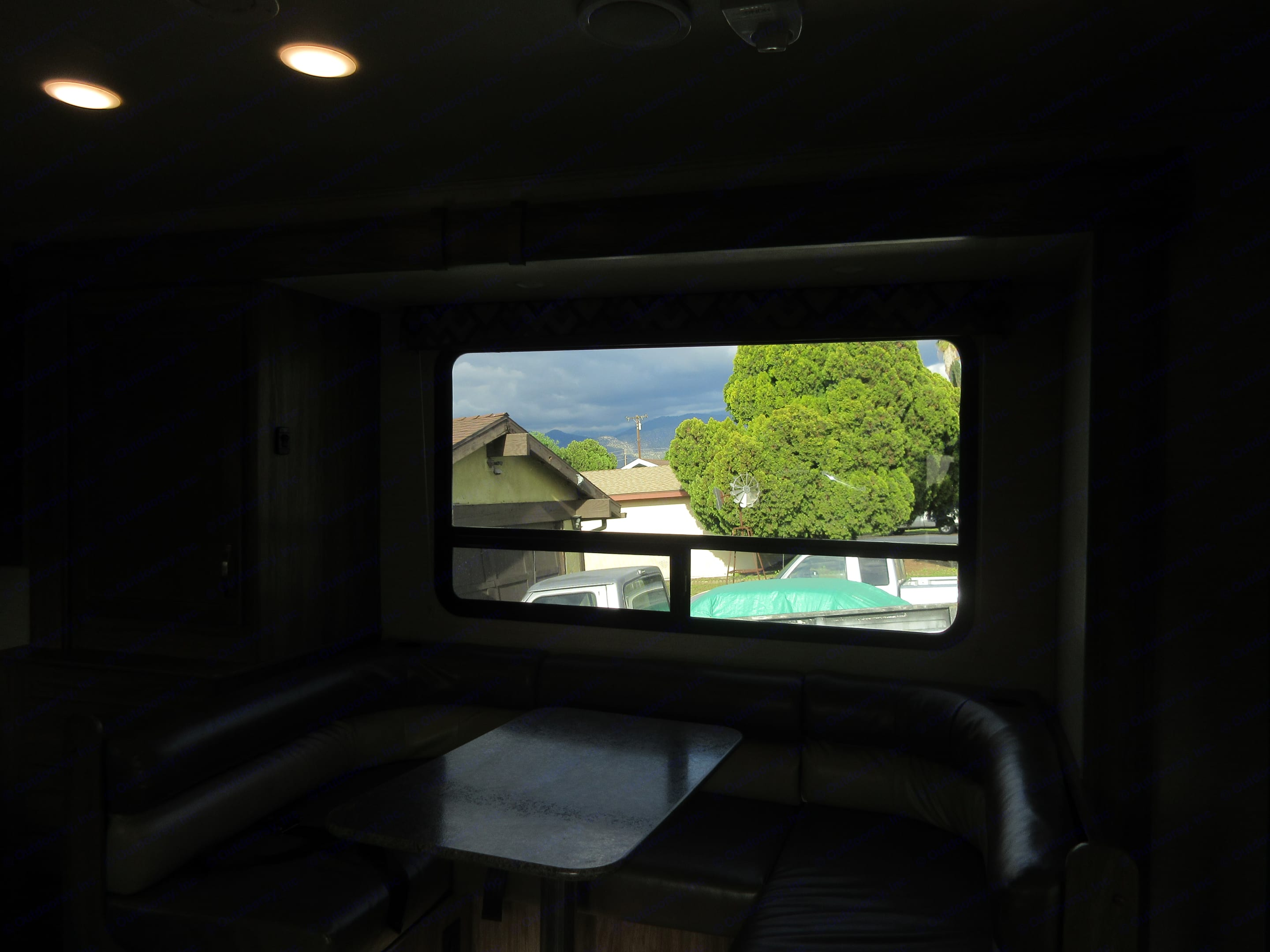 From the entrance view of the dining area of the RV.  When parked the dining area allows for more space by pressing a button to expand this space outward.. Jayco Redhawk 2018