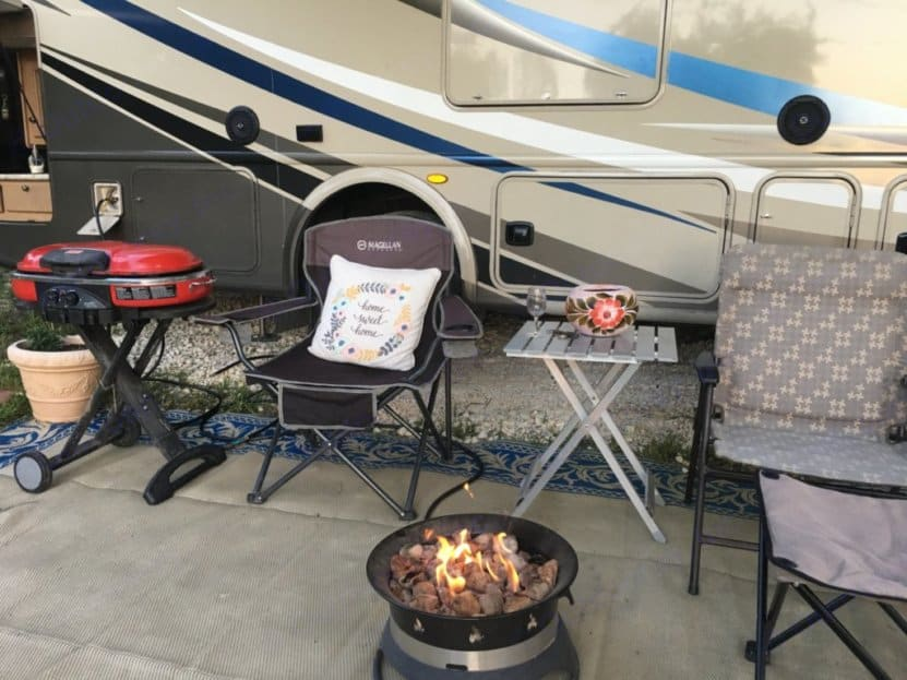 This easy to light included firepit brings the ambiance of a firepit without the hassle of gathering wood  . Thor Motor Coach Windsport 2018