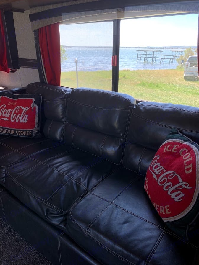 Comfortable couch with fold down drink holder.. Heartland Trail Runner 2018