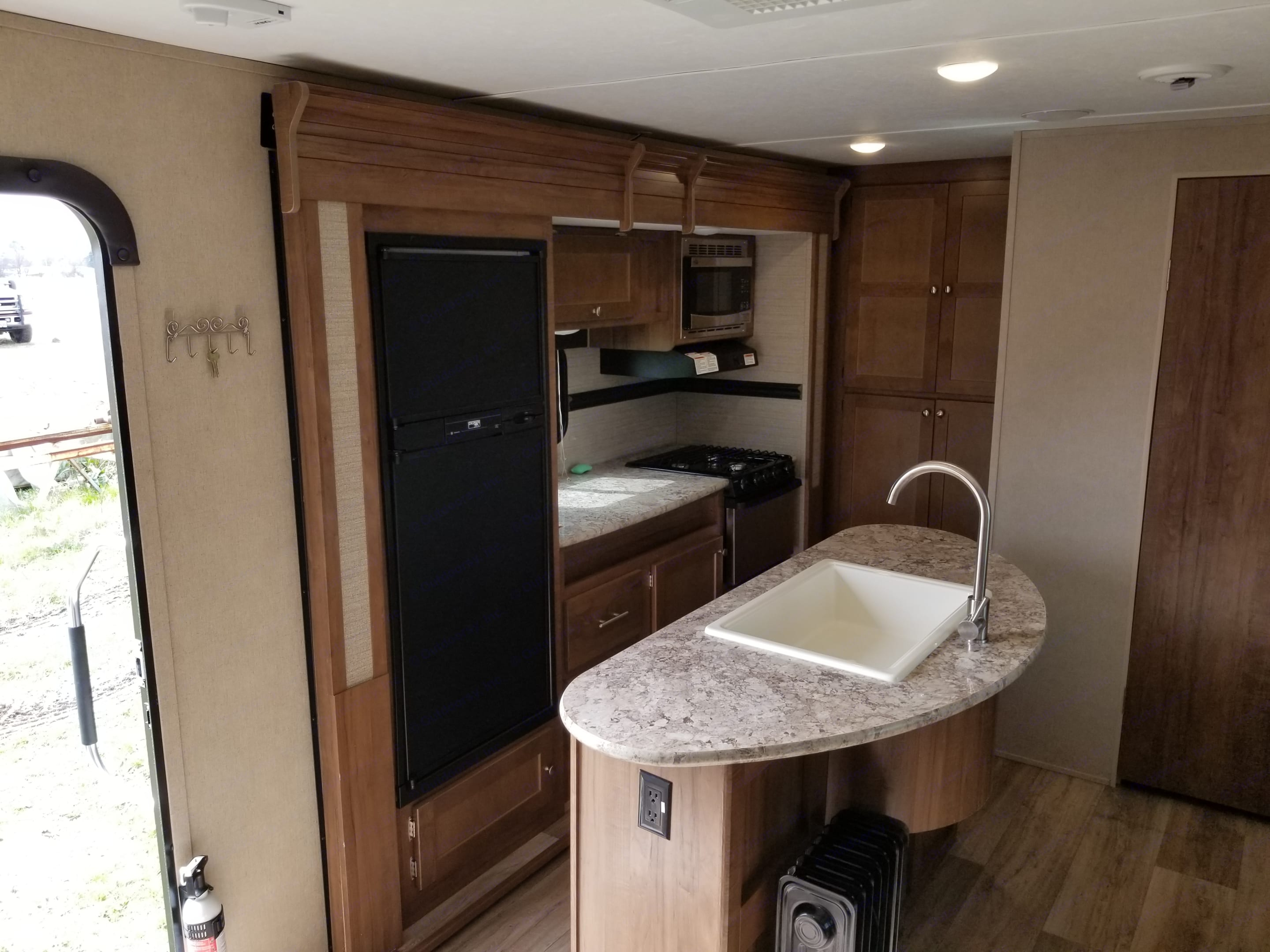 Kitchen with Island and large pantry. Dutchmen Aspen Trail 2018