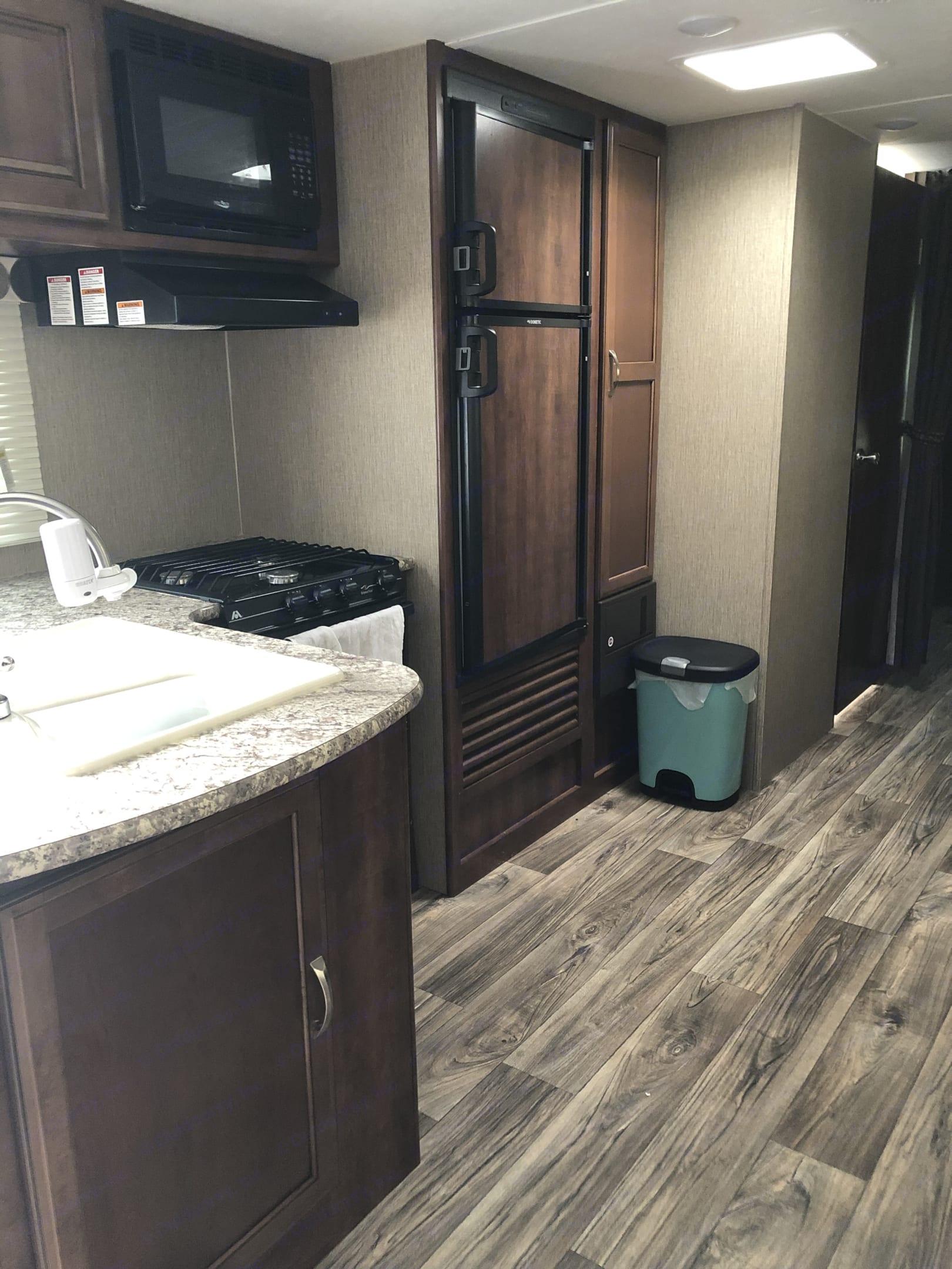 Fully stocked kitchen . Keystone Passport 2018
