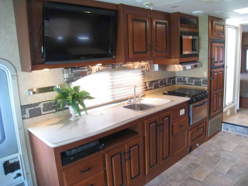 Full kitchen and lots of counter space. Thru counter garbage keeps the walkway open.. Forest River Forester 3011DS 2011