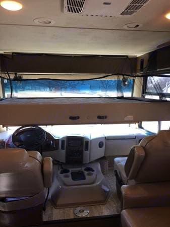 Overhead bunk - queen size bed. . Thor Motor Coach Hurricane 2016