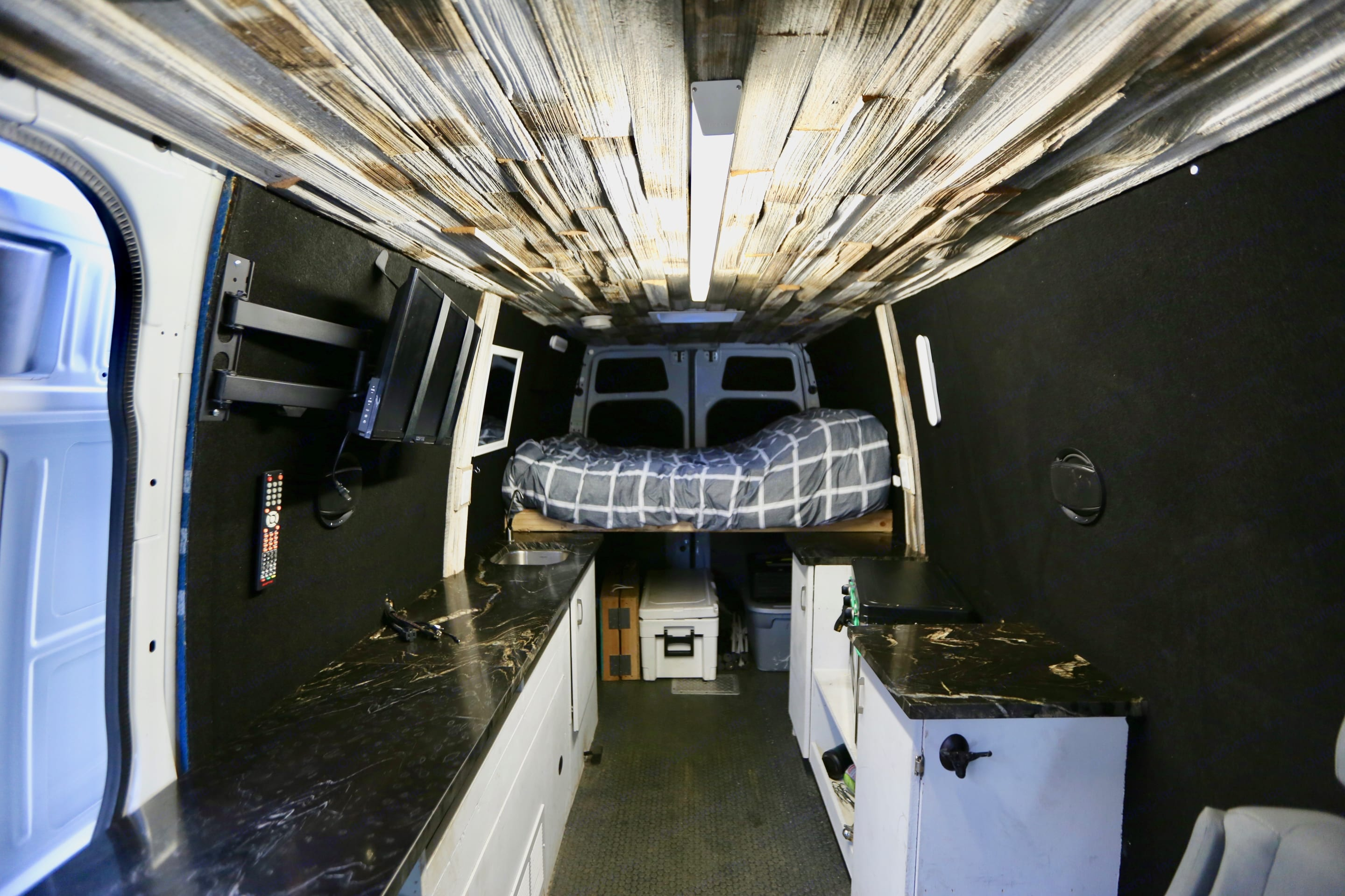 """Bed platform at the rear of the van. With the bed extension the bed can run both """"east/west"""" and """"north/south"""" which provides more length.. Mercedes-Benz Sprinter 2013"""