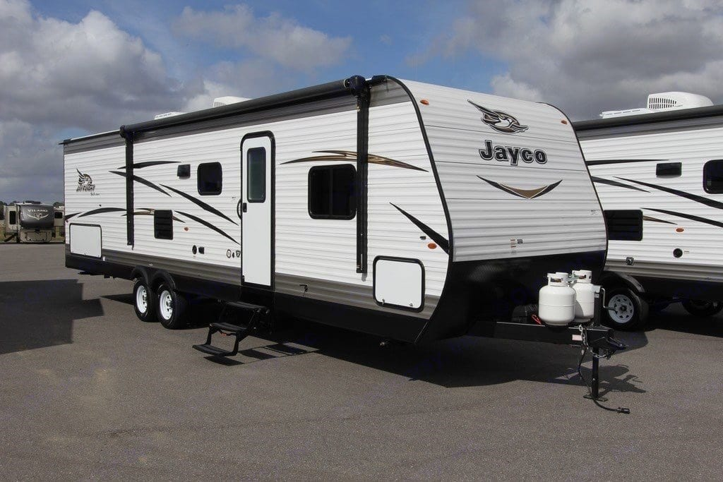 Brand new 35 ft. travel trailer with a large awning and plenty of outdoor storage.. Jayco Jay Flight 2018
