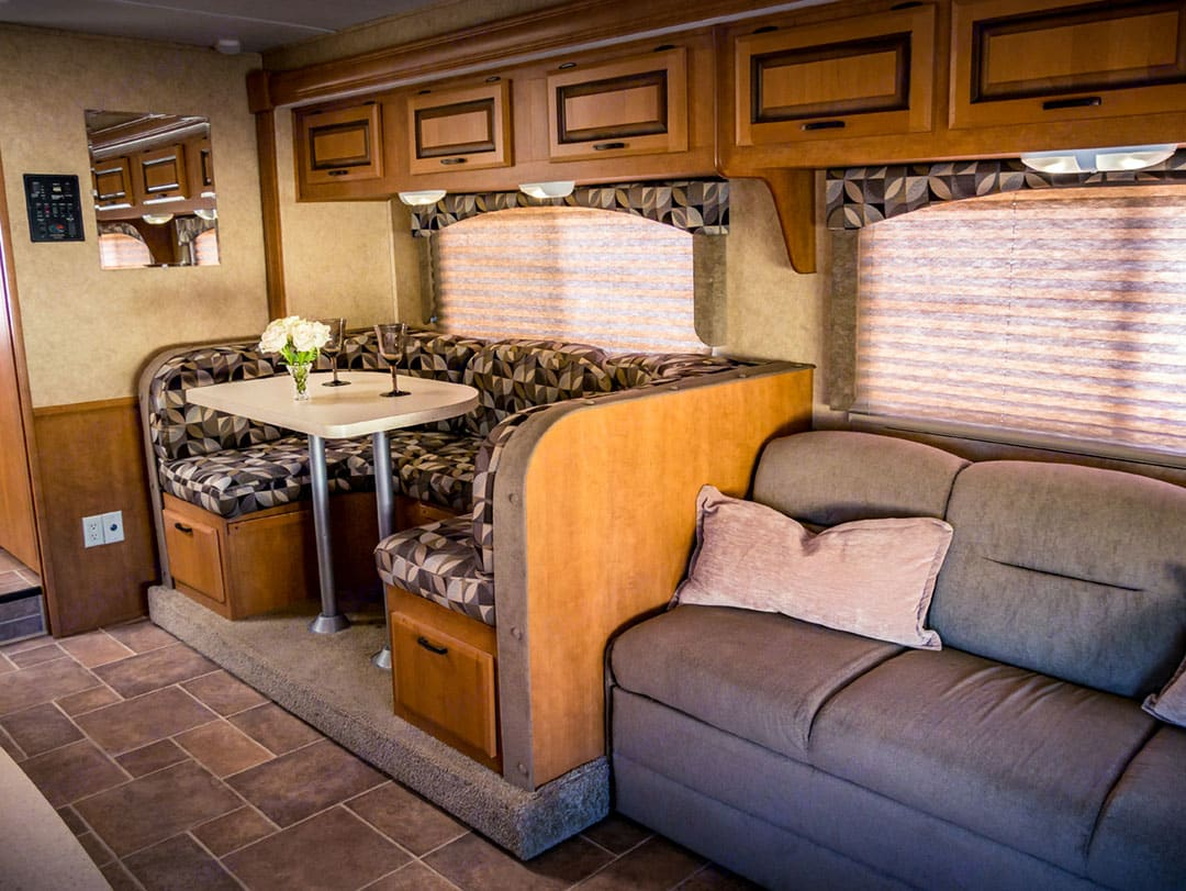 Luxurious couch and booth. Both convert to beds!. Forest River Sunseeker 2012