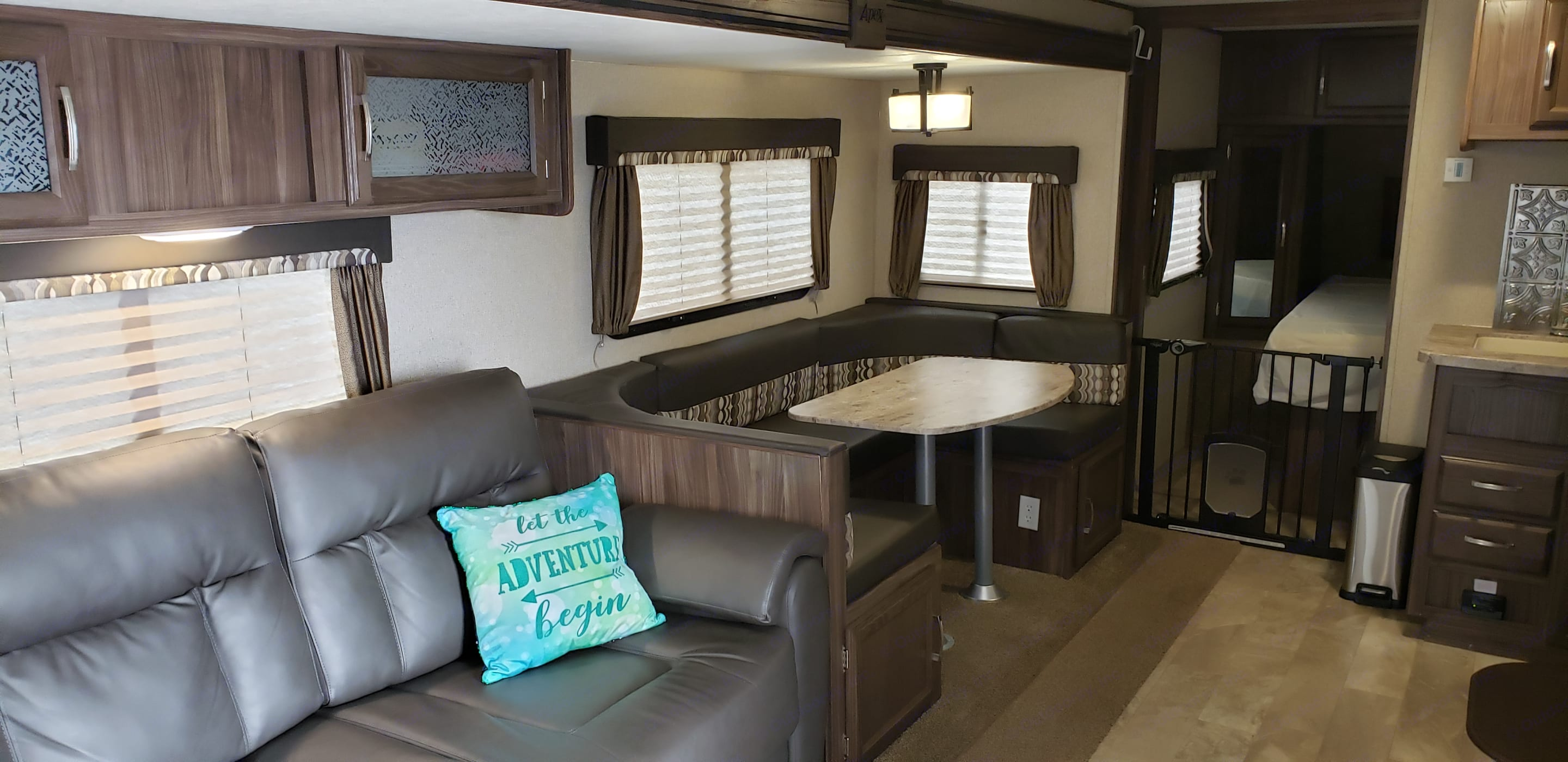 Pet gate seperating the bedroom, in addition to, the full size door that can be closed. . Coachmen Apex 265rbss 2019