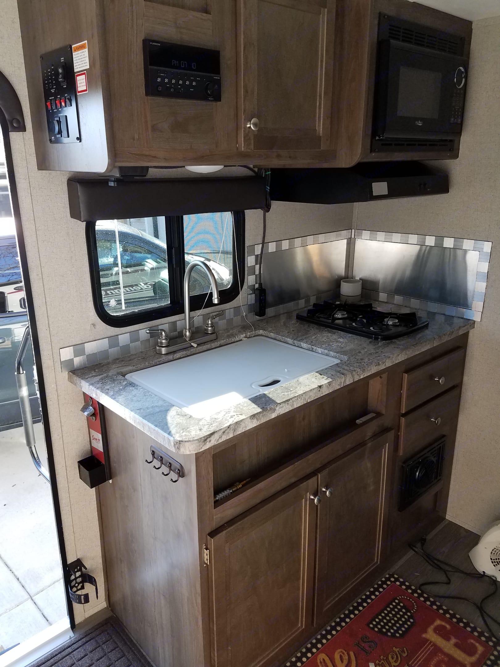 Nice kitchen area. Dutchmen Coleman Light 16RB 2018