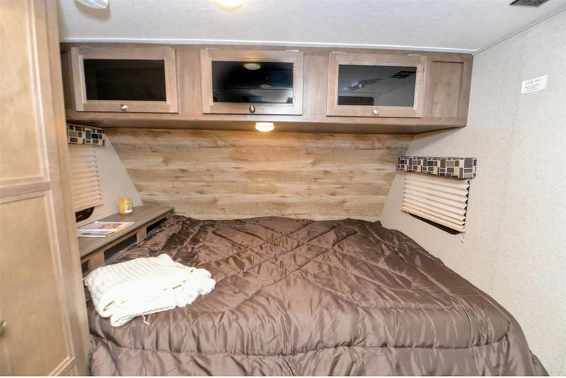 60X80 Queen bed with storage headboard. New memory foam mattress not the original rock that comes standard.. Dutchmen Coleman Light 16RB 2018