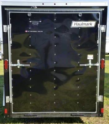 Full width rear ramp door for easy loading of ATV's or cargo on a hand truck . Haulmark Passport 2014