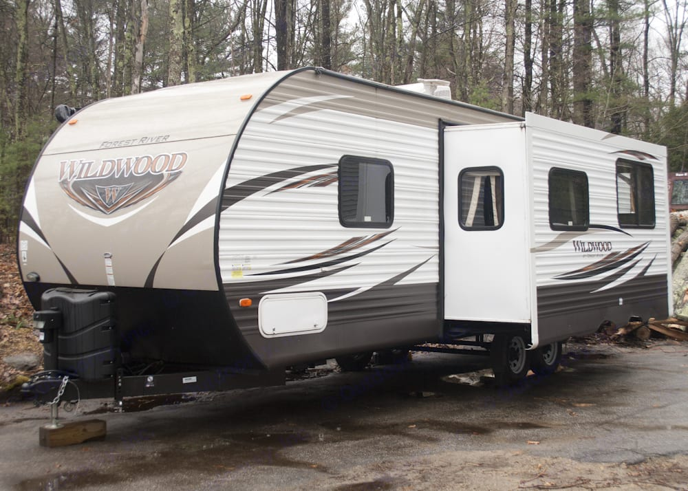 Exterior view of trailer shown with slide out.. Forest River Wildwood 26TBSS 2017