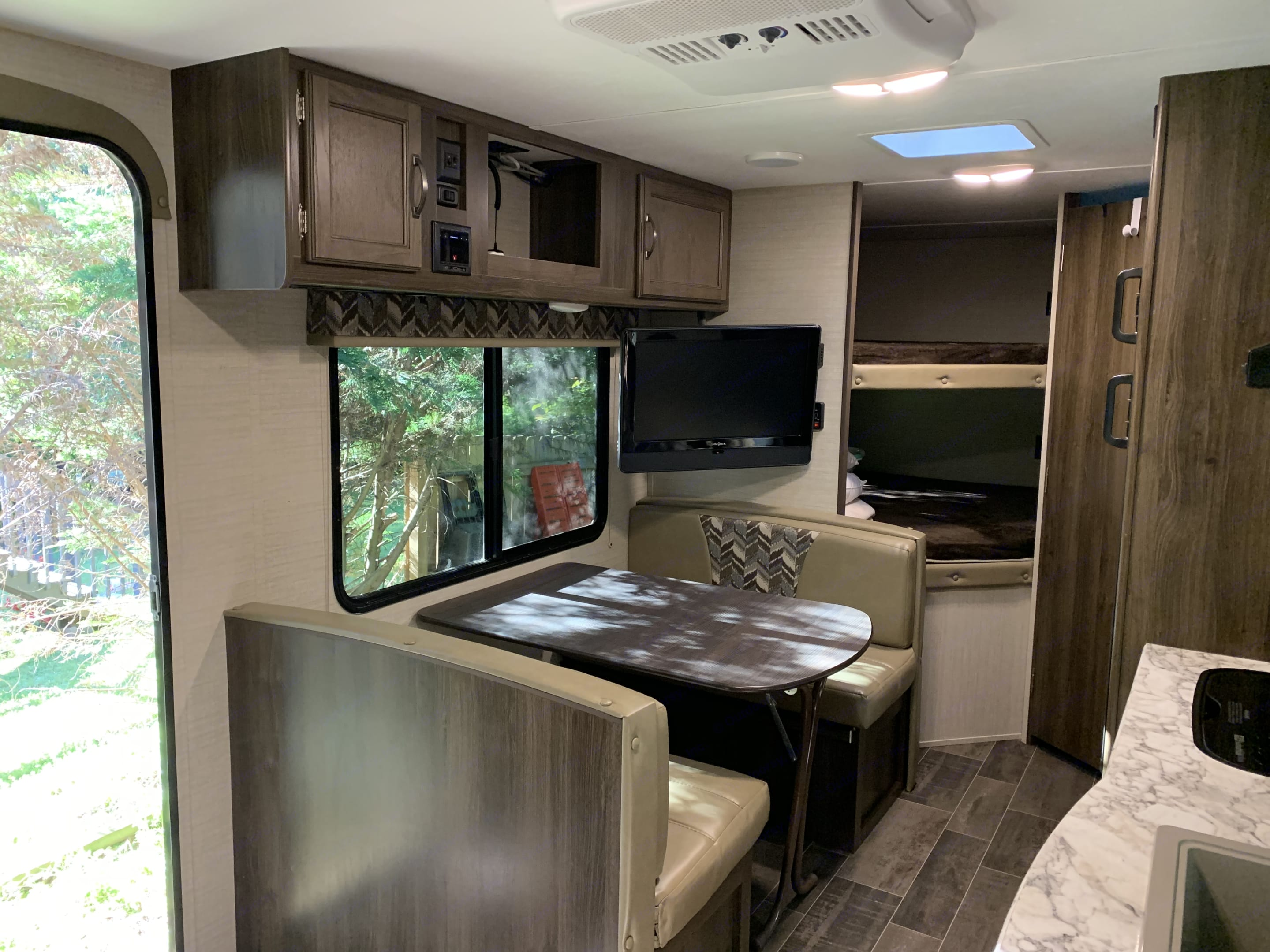 Dinette with Upper Storage and Storage Under the Seats. Keystone Bullet Crossfire 2018