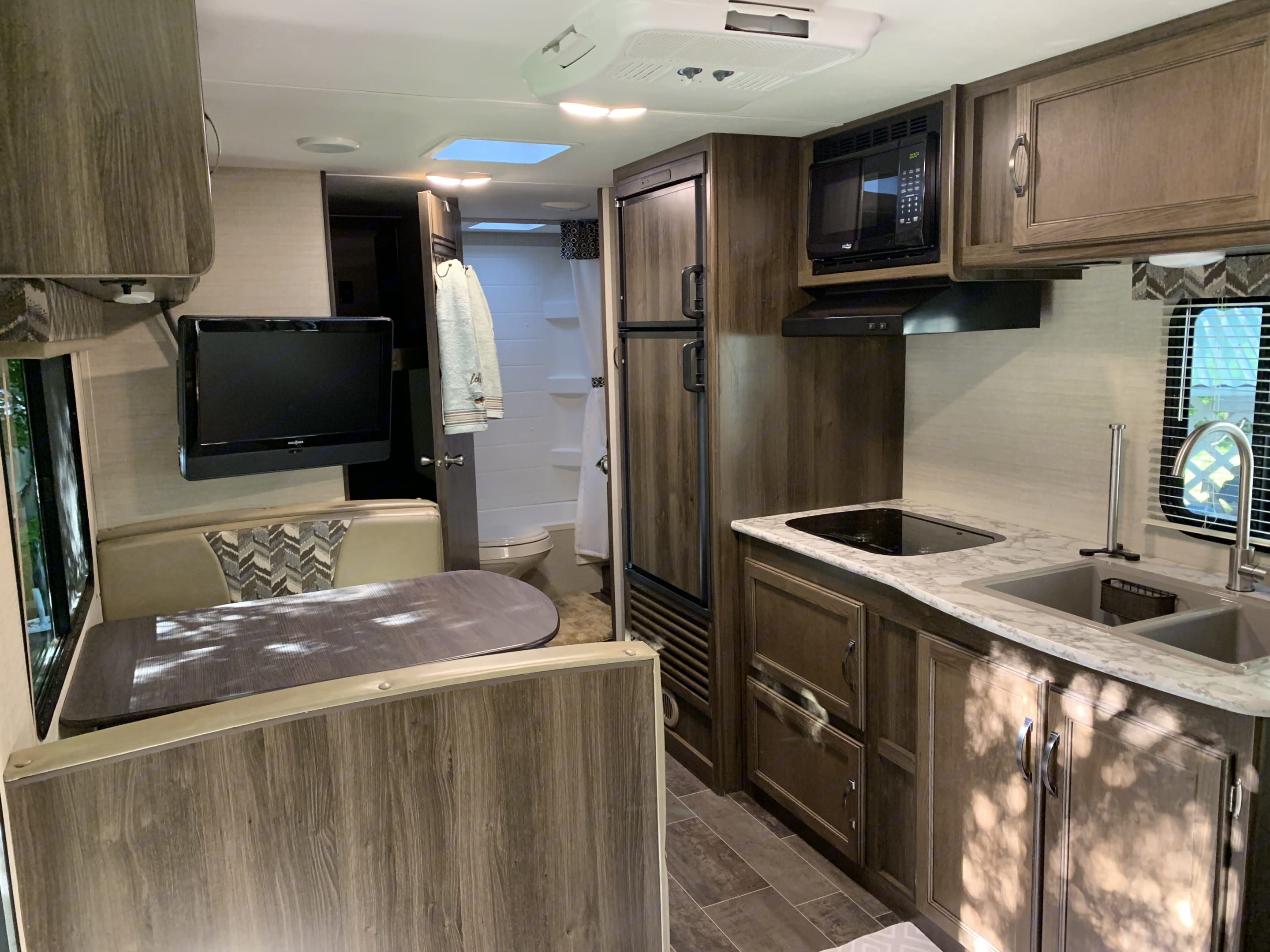 Looking Left as you enter camper.  Awesome Very Cold Air Conditioner and Central Heat if your need it. Windows and upper vents can open if you prefer a nice breeze instead.. Keystone Bullet Crossfire 2018