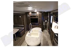 Looking towards the front of the trailer.  You can see the kitchen, and doorway to the master bedroom. . Coachmen Apex 2019