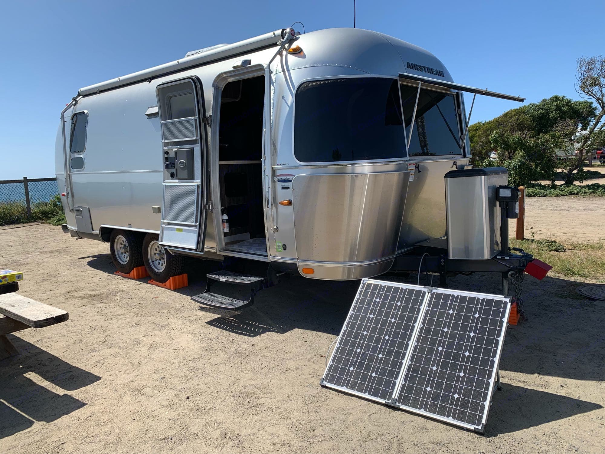 this little solar panel keeps the battery charged for all basic needs. Airstream International 2015