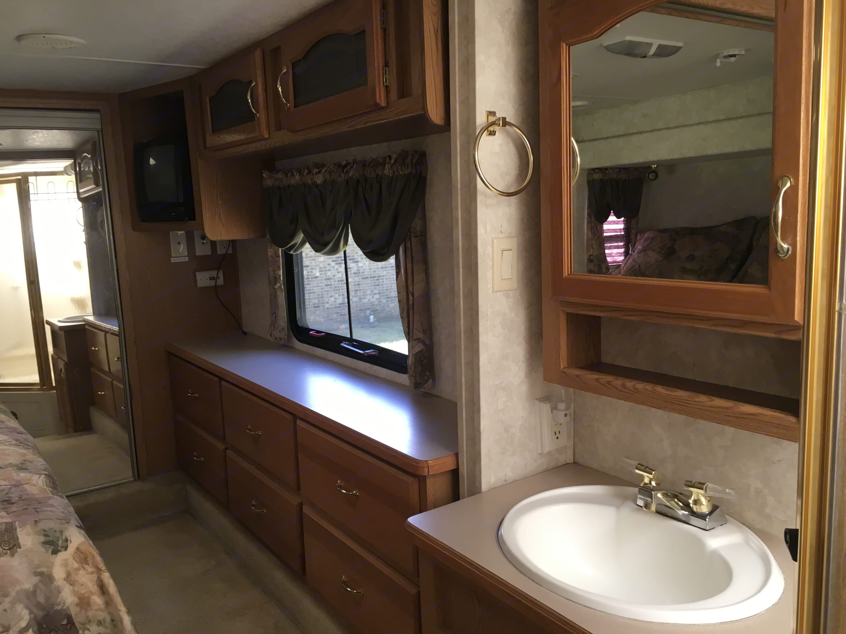 Master suite with queen sleep number bed, plenty of storage and closet space. Television. . Keystone Montana 2004
