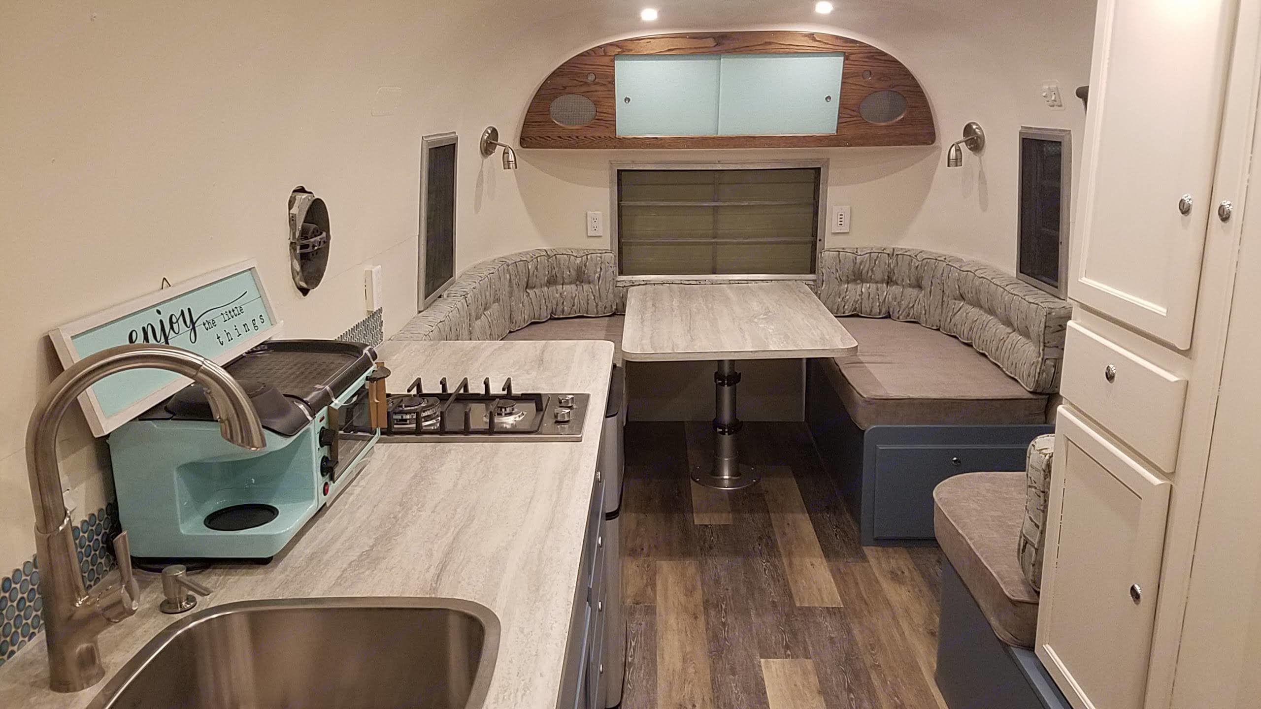 Front of camper, table converts to queen bed. Avion Other 1963