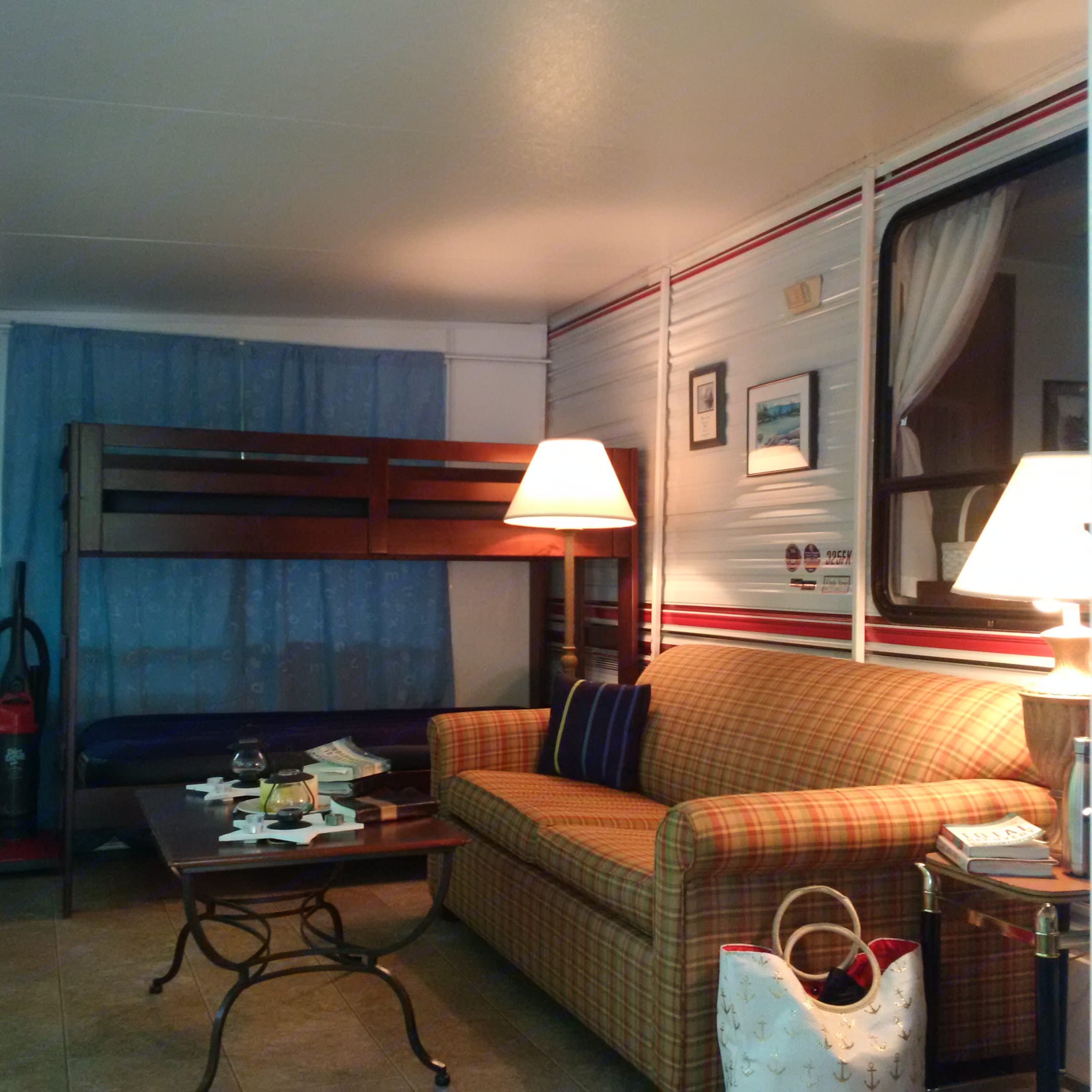 Sun room interior view - bunk beds and pull-out couch. Jayco Eagle 1992