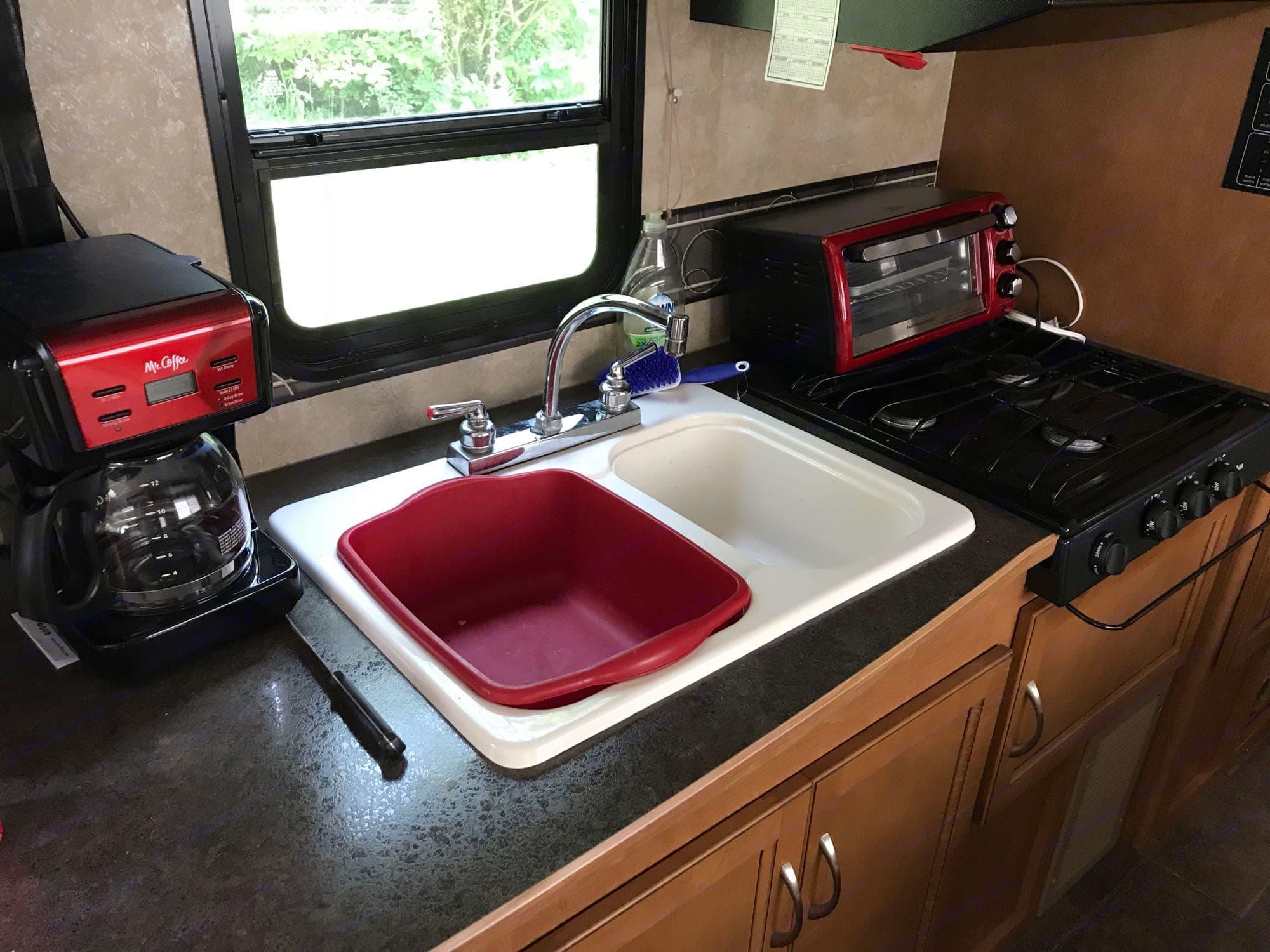 Two tub sink, propane stove and of course, coffee pot!. Winnebago Minnie Winnie 2014