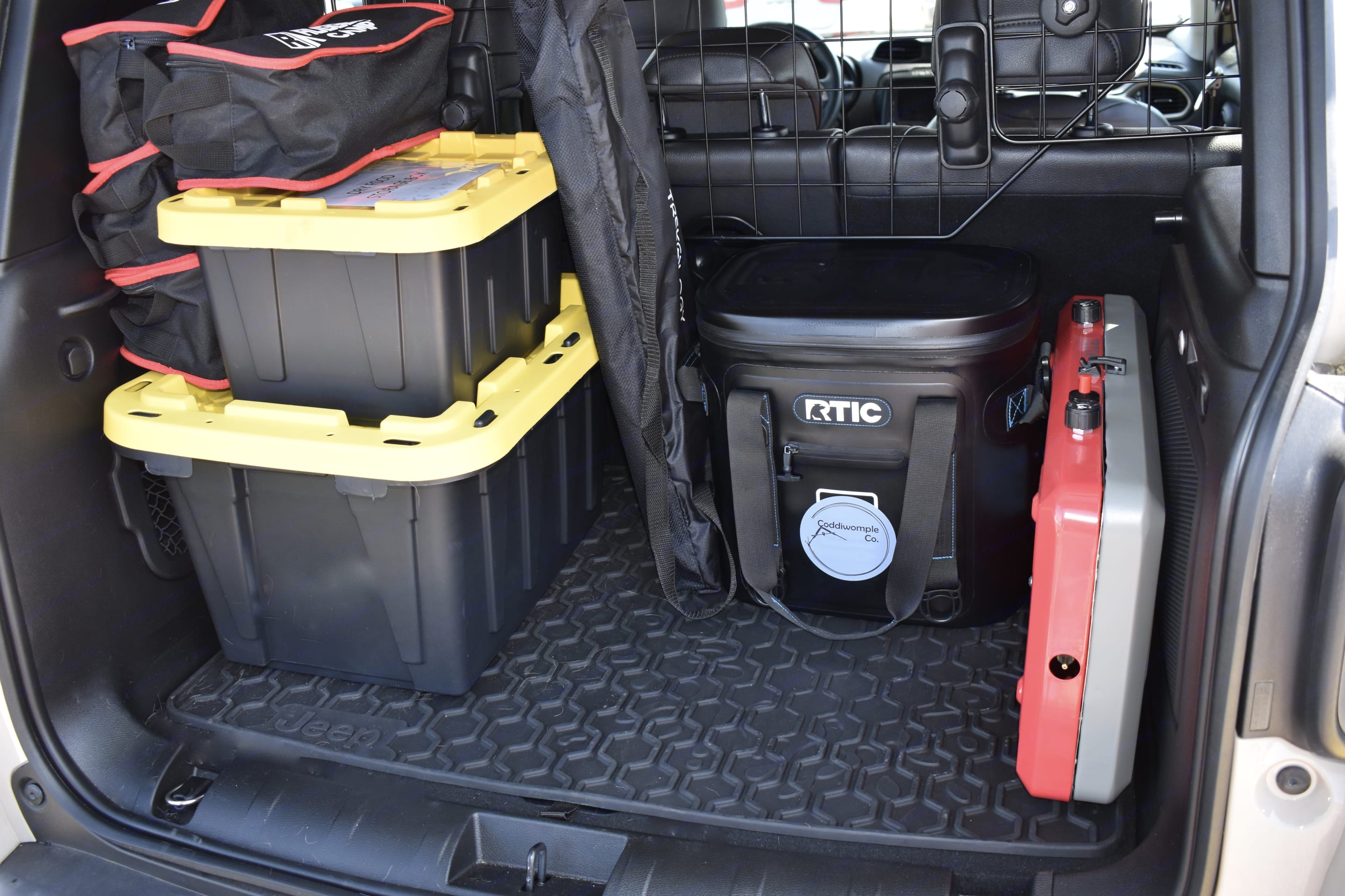 Gear included: gas stove, cooler, table, chairs (4), dry food storage container, cooking equipment, first aid kit, tire repair kit, full size spare tire, car jump-starter/power pack. . Jeep Renegade 2017