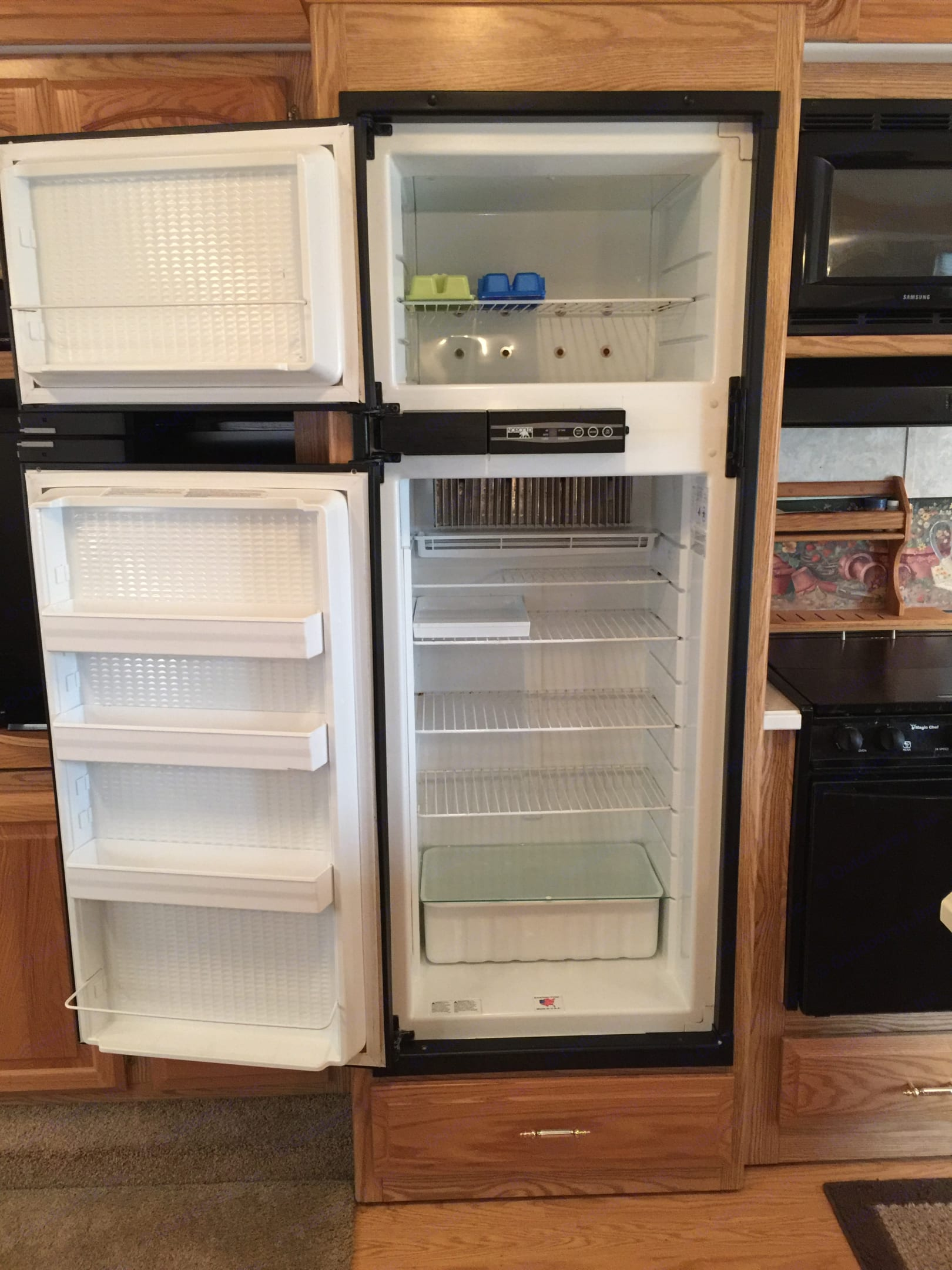 refrigerator and freezer, works very well, propane or electric. Carriage Cameo 2003