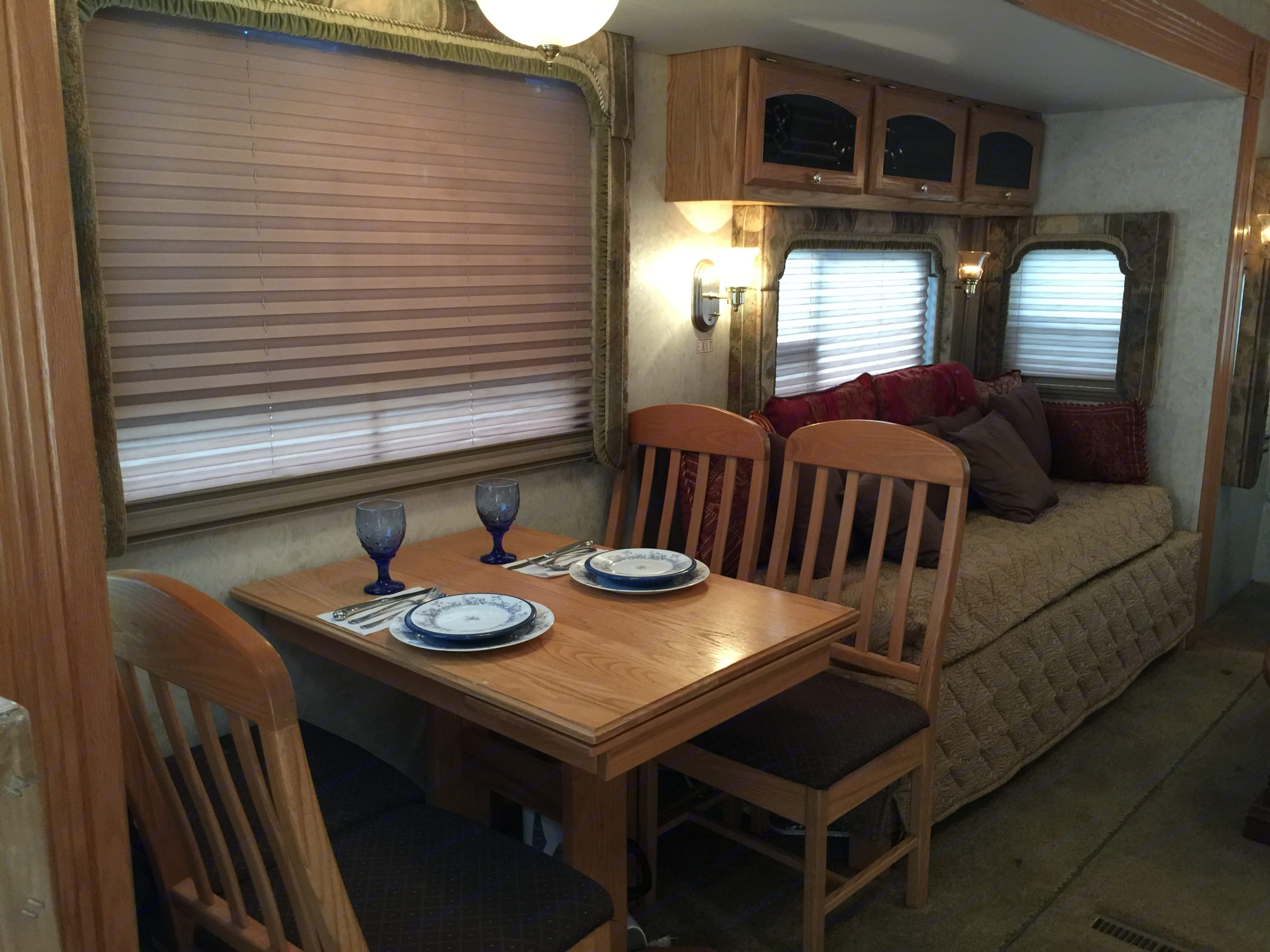 Dining area with living room couch on door side slide. Carriage Cameo 2003