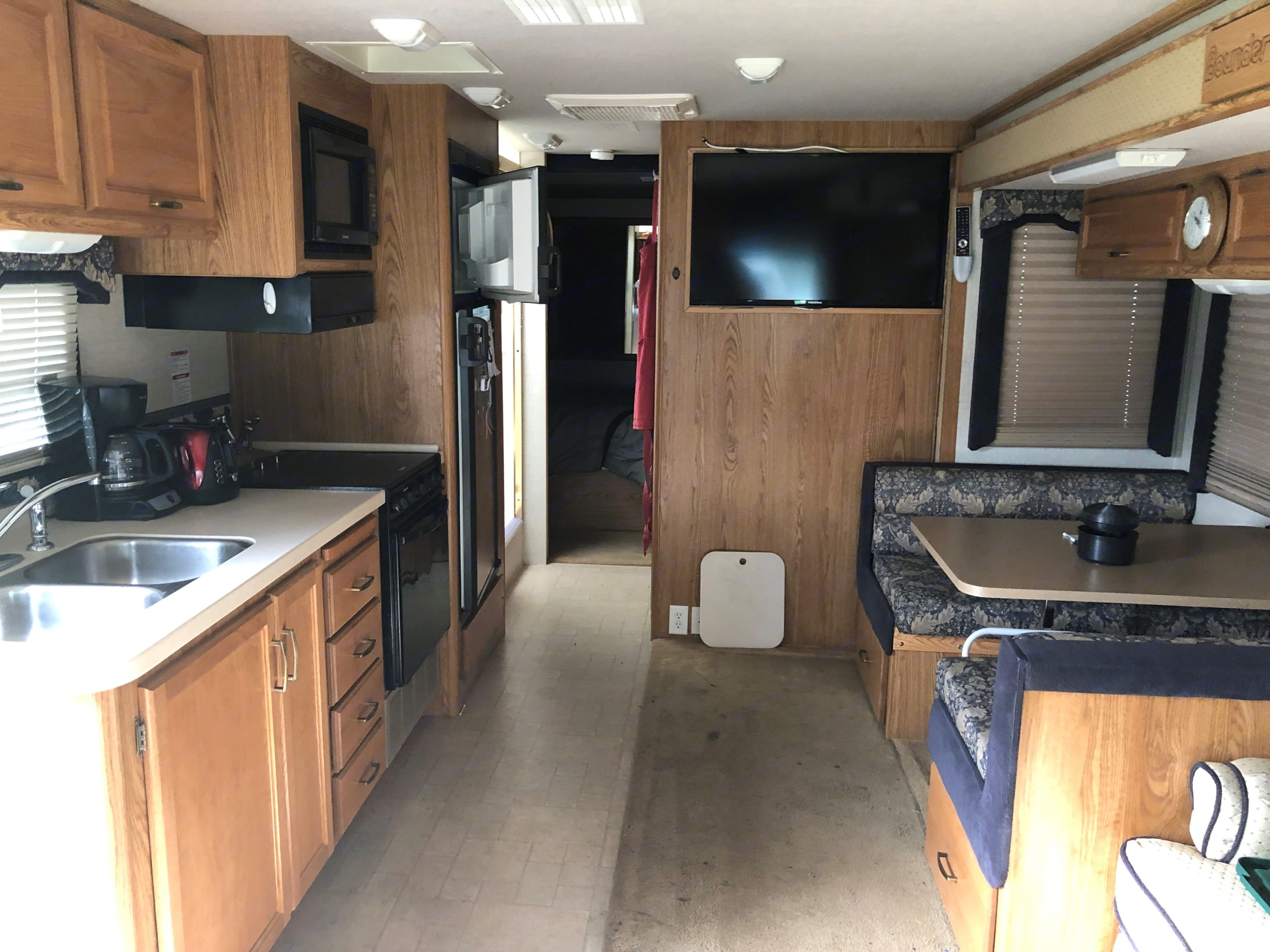 Living space, 48 inch screen tv, sink, range, stove, microwave and two phase refrigerator. Fleetwood Bounder 2004