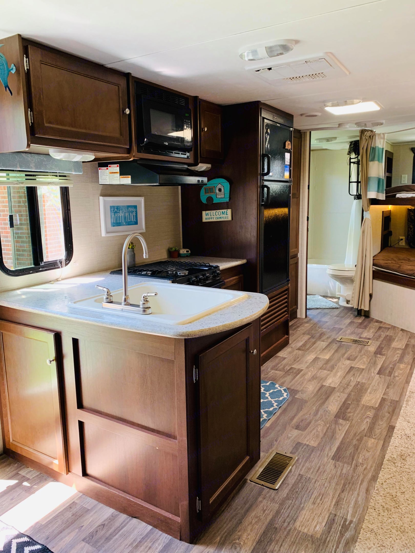 View of the main living space and full size bunk beds . Keystone Bullet272BHS 2016