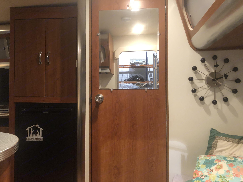 Door to bathroom. Fridge to the left. Shasta Airflyte 2009