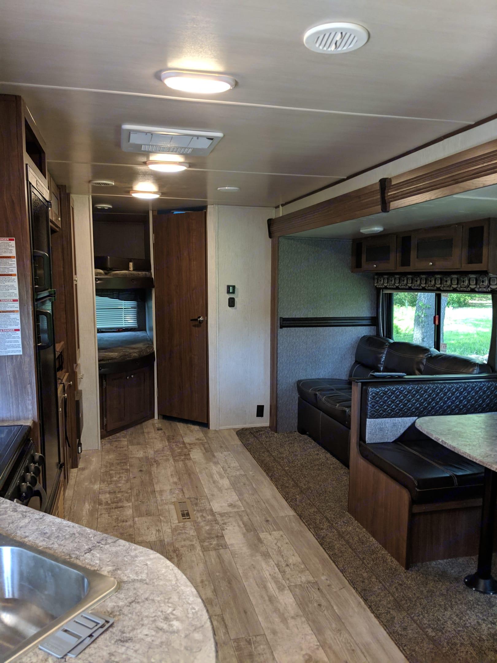 Living Space - 2 bunks on left. Heartland Pioneer 2019