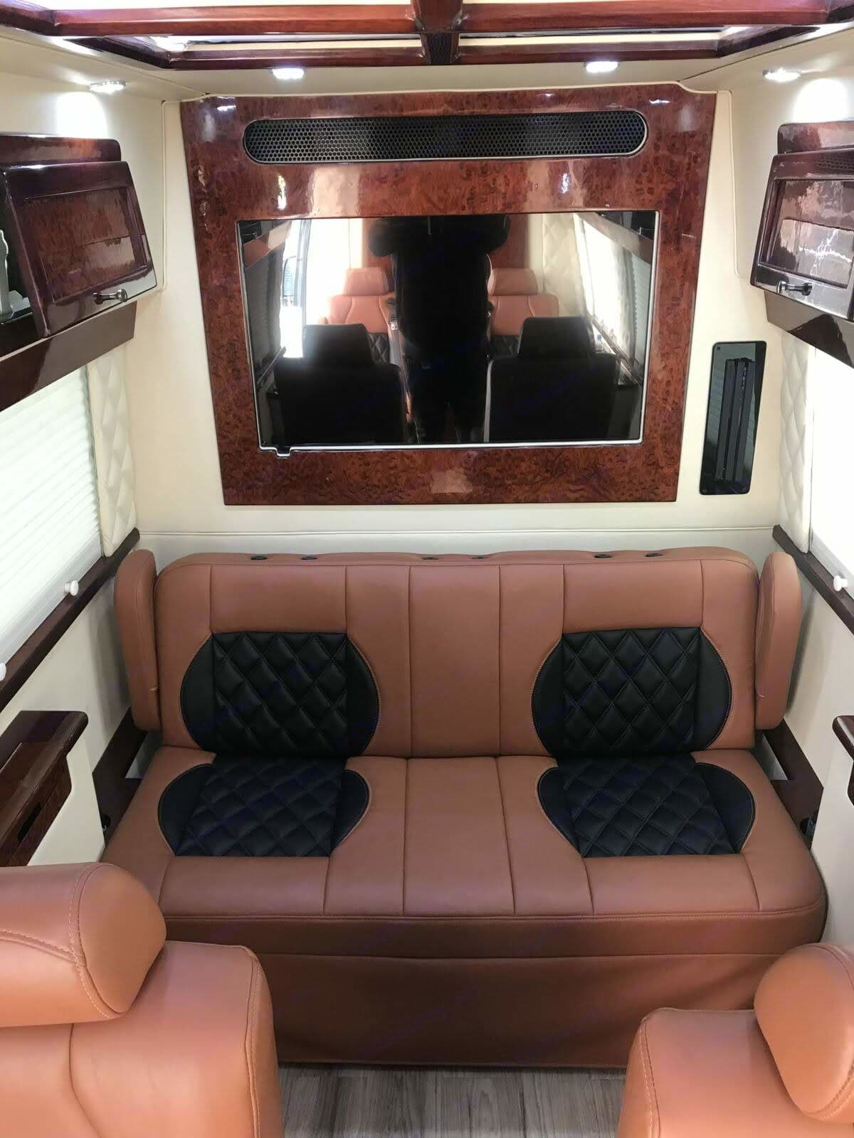 The bench at the end of the cabin is electric with a touch of a button the bench seating turns into a bed. Also has PlayStation 4 that you can see on the right side of the back wall. Mercedes-Benz Sprinter 2013