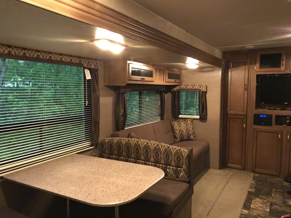 The dinette and couch turn into beds. But the tv doesn't. There is a cribbage board in the cabinet above the couch, so you can impress your friends with your math skills.. Coachmen Catalina 2015