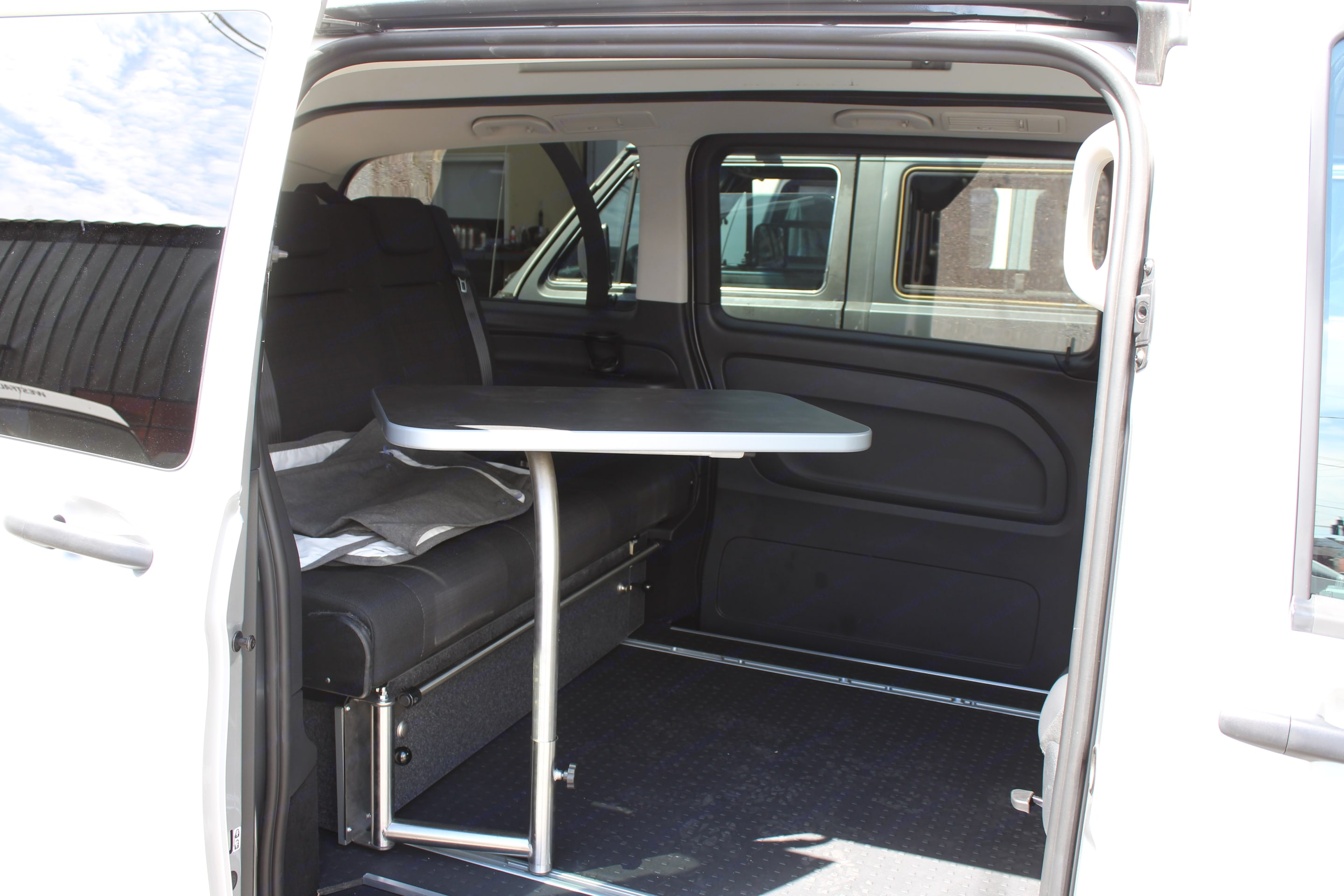 A convenient table pivots inside and outside of the van and stores behind the seat for convenient use.. Mercedes-Benz Other 2018