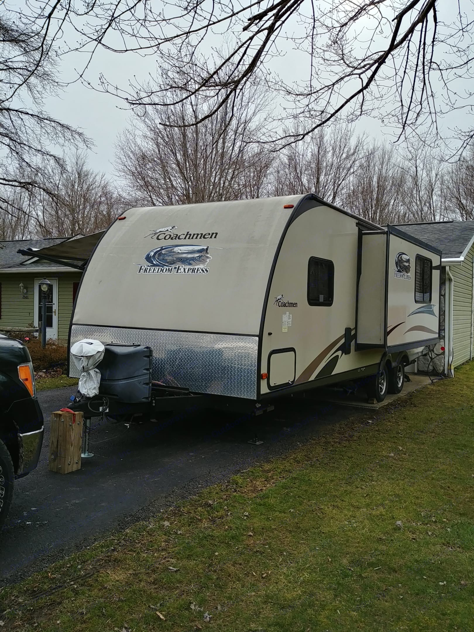 There is a 16 inch slide out for the living, eating area,  Tung jack and stabilizers are electric. . Coachmen Freedom Express 2013