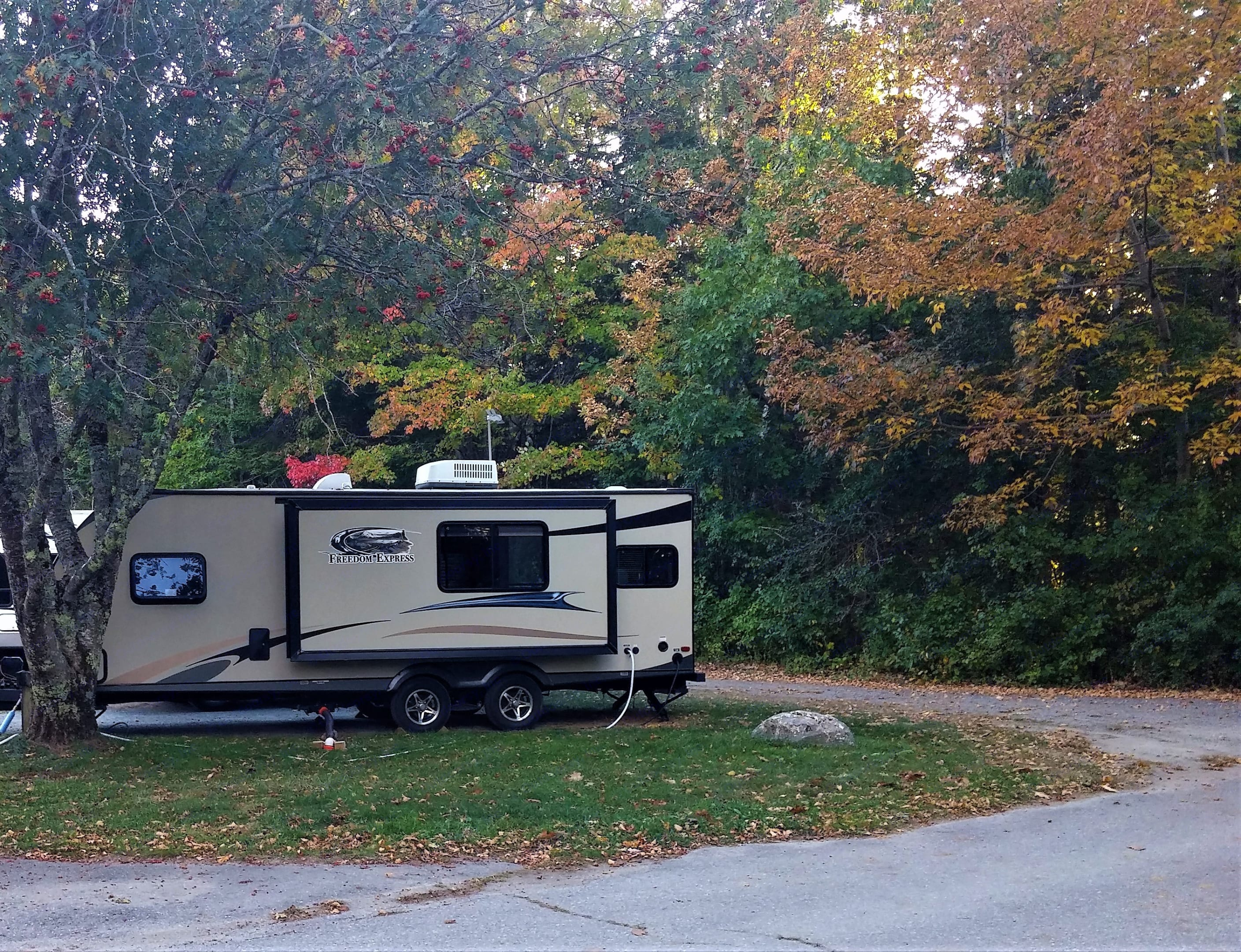 Features an outdoor hot / cold water shower.  Hadley's Point  Bar Harbor. Coachmen Freedom Express 2013