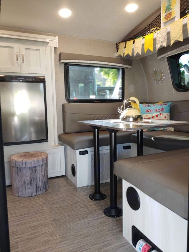 The entry into the dinette has a nice size refrigerator with a cute faux wood storage which holds the kitchen linens. . Forest River GeoPro 2020