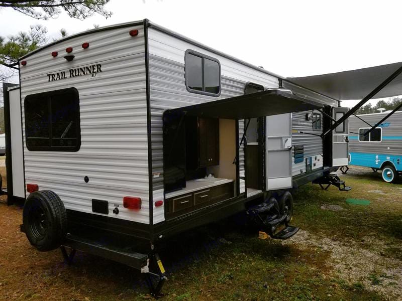 Outdoor kitchen has refrigerator, sink, and cable TV access. Heartland Trail Runner 2018