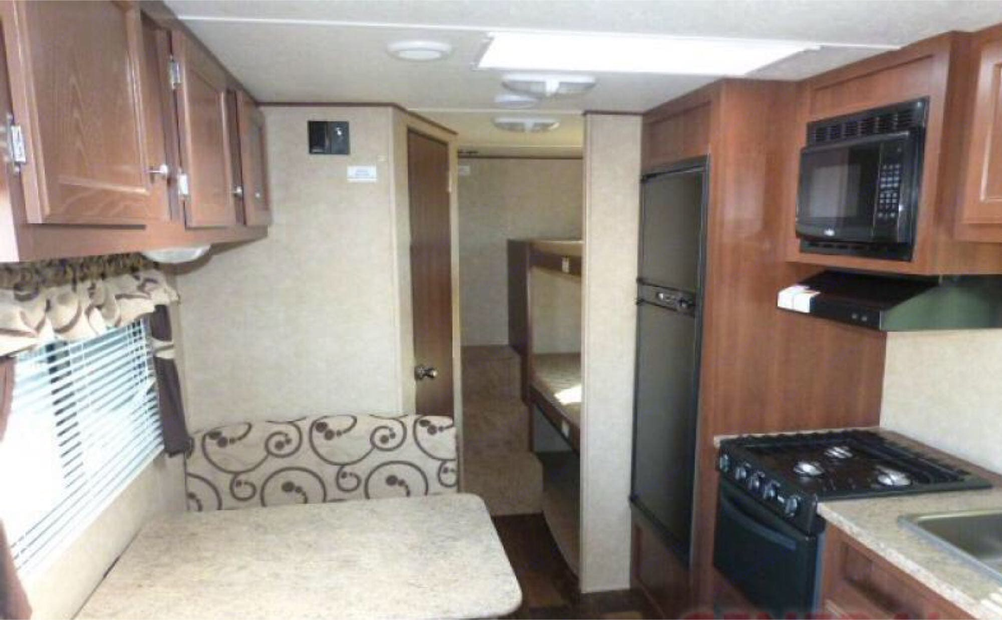 kitchen table converts to additional bed. Three (3) back bunks with nightlights on each bunk.. Crossroads Z-1 2014