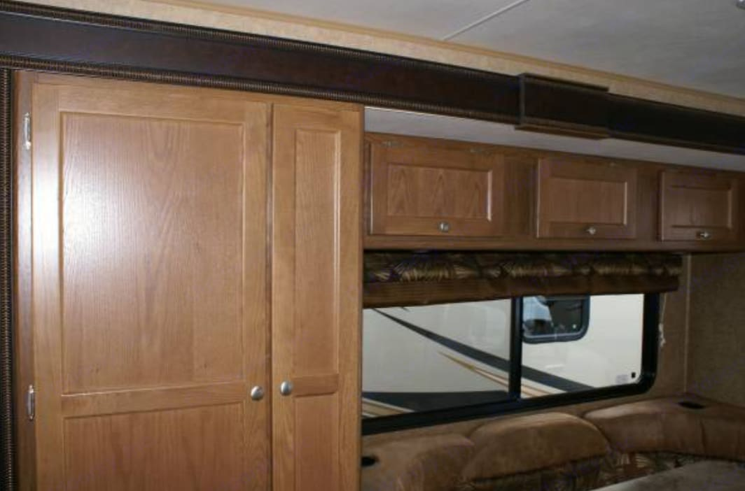 Storage above dining area. Coachmen Leprechaun 2017