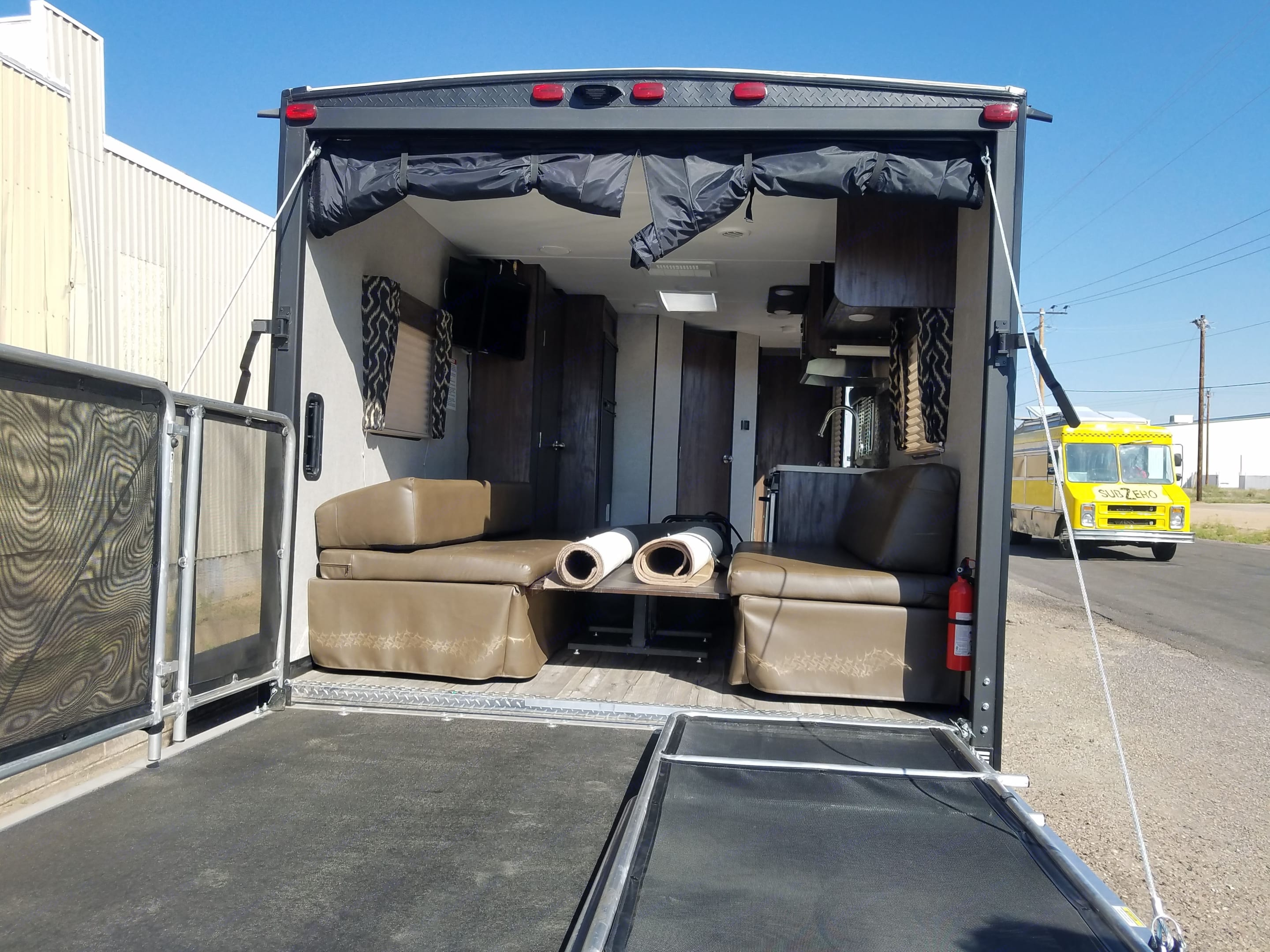 The back of the trailer with the deck out.  . Forest River Cherokee Grey Wolf 2018