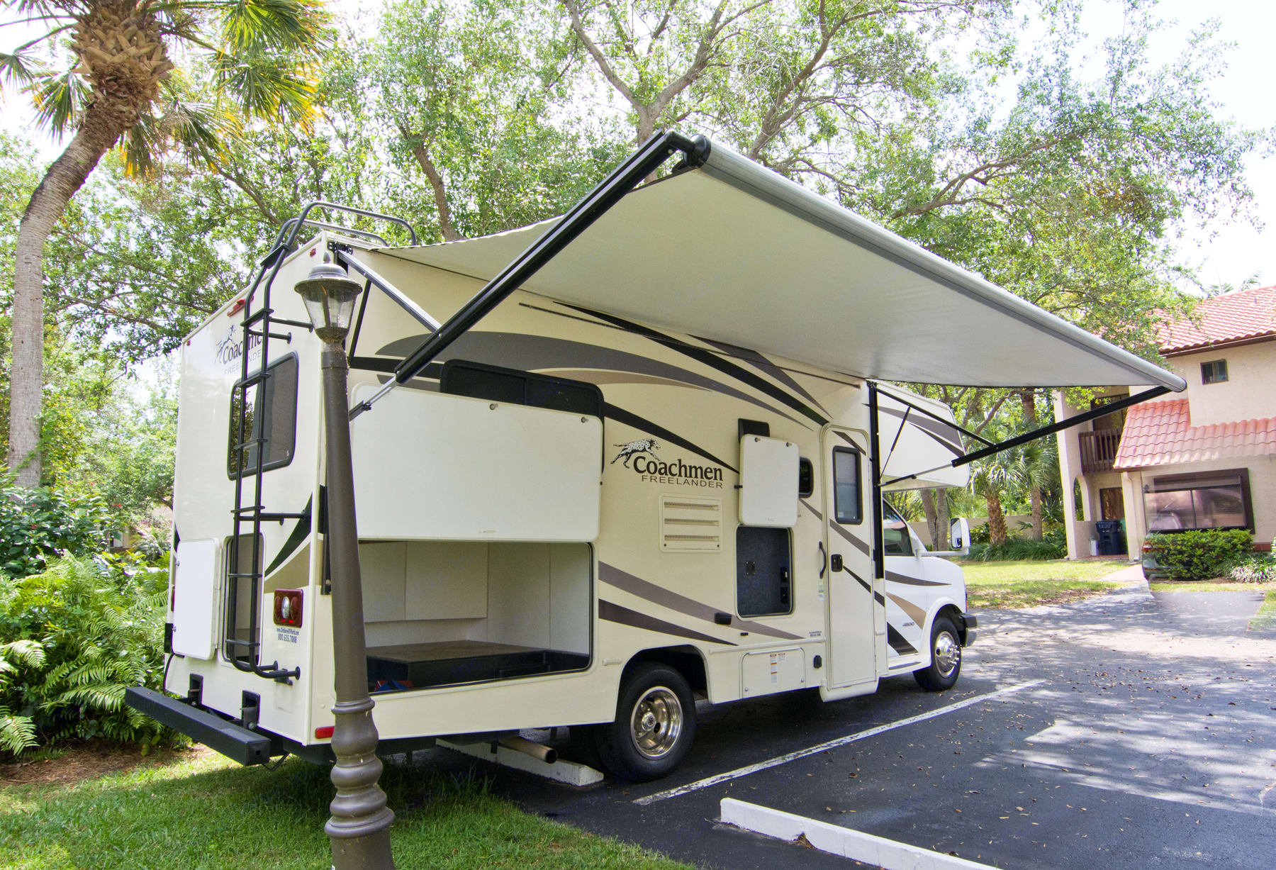 Open electric awning to watch to star gaze or barbecue. ALL this storage space for camping gear, cycling gear, fishing gear and luggage. Two way entry to compartment.. Coachmen Freelander 2017