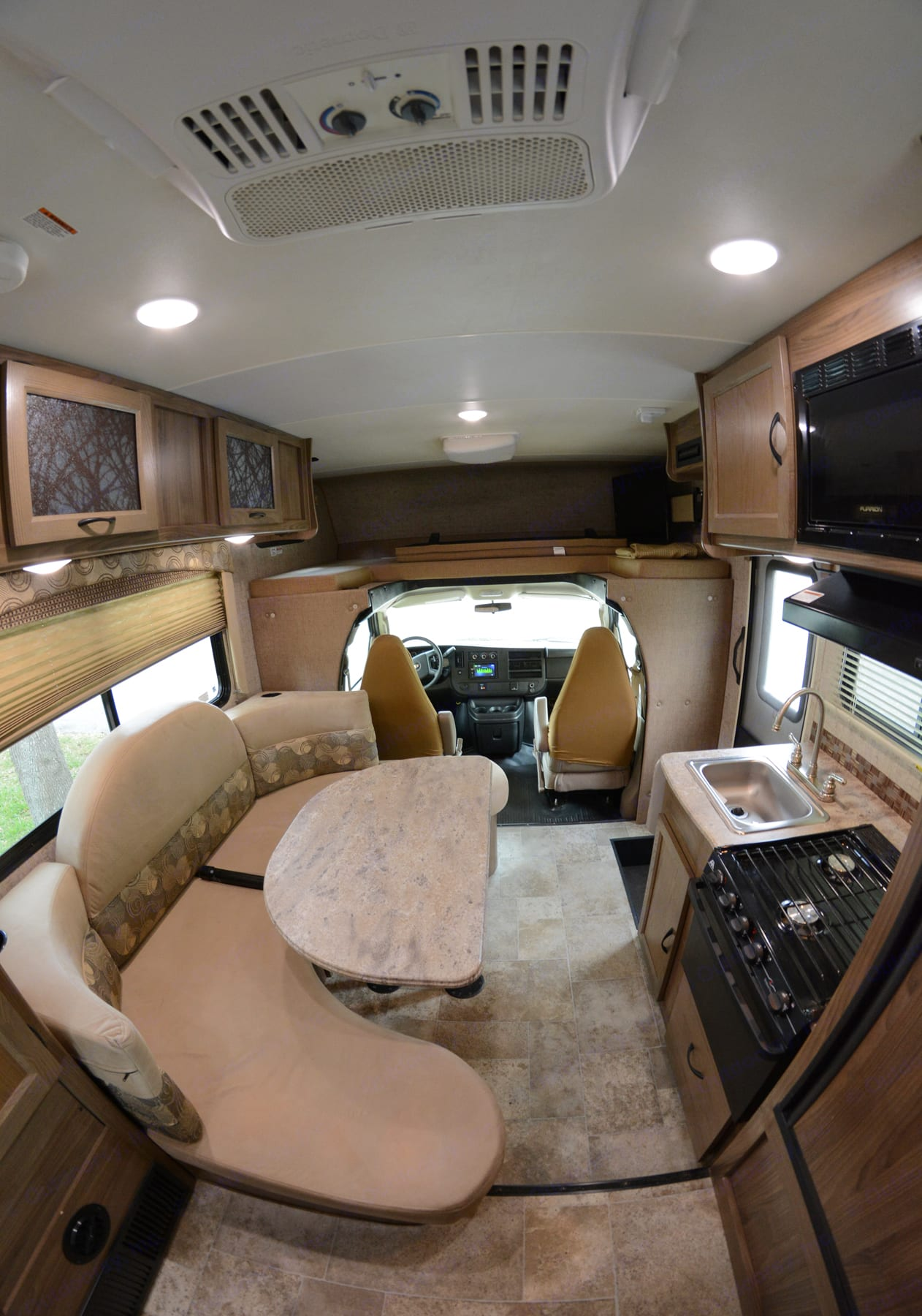 Driver and passenger seat above bunk or cab house for sleeping two more people. One flat screen to the right fully loaded. Dinette area with removable table.. Coachmen Freelander 2017
