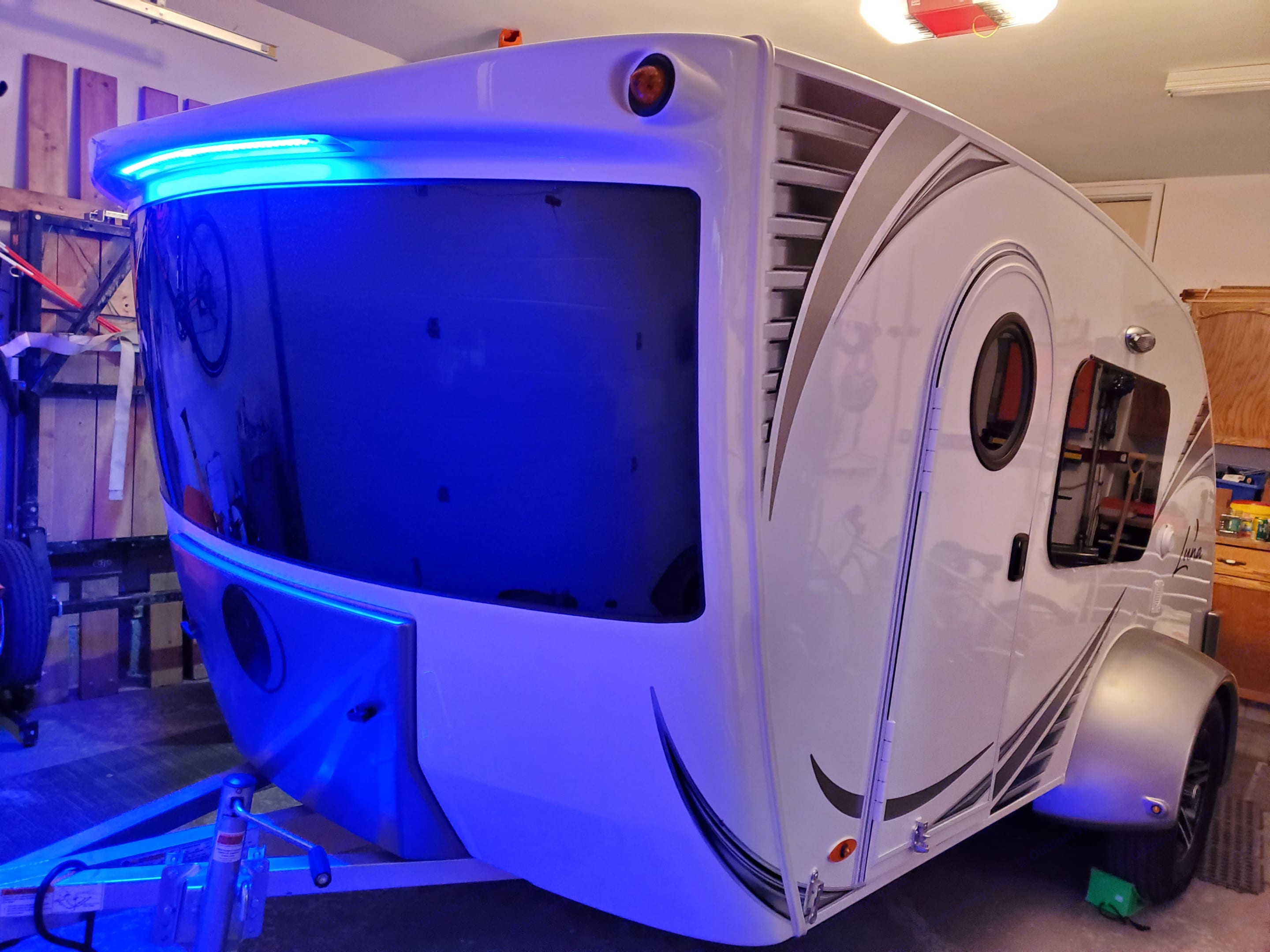 Outside view of 180 degree panorama screen and LED lights to have the coolest trailer in a campground. You can manually point the trailer so you can enjoy the mountain view while having a coffee inside.. InTech RV Luna 2018
