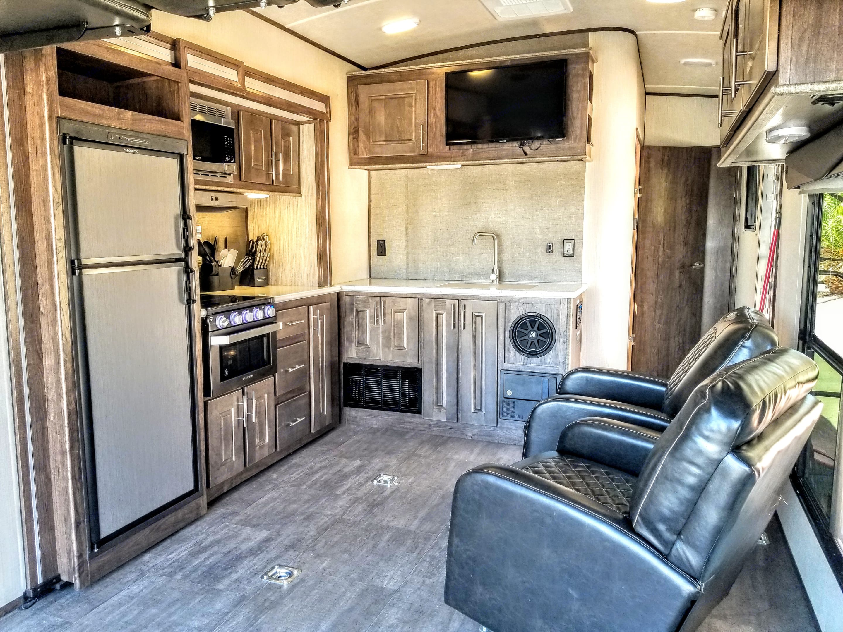 Good size kitchen, slide is fully extended. . Cruiser Rv Corp Stryker 2613 2019