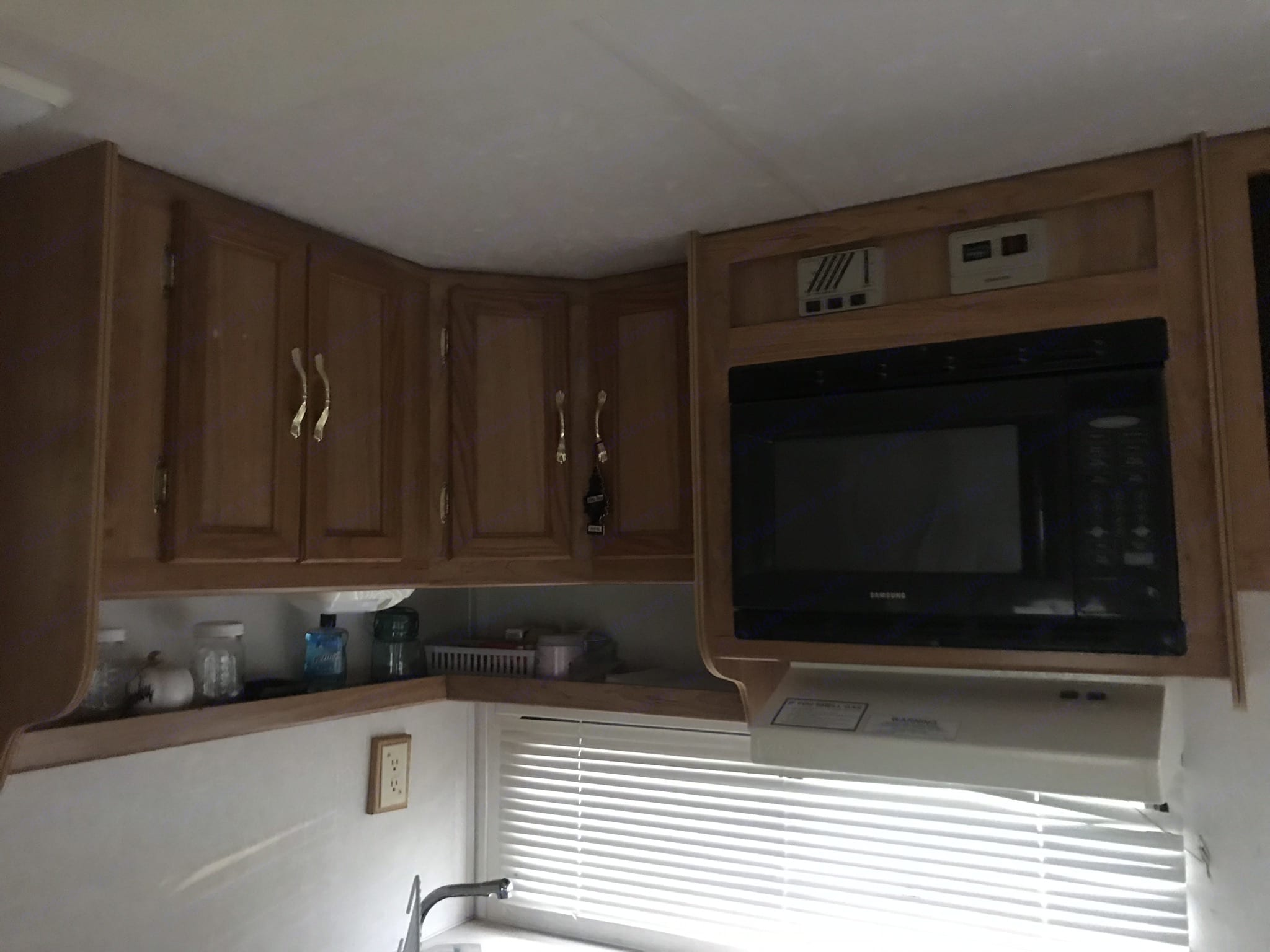 Kitchen cupboards  . Coachmen Pathfinder 2001