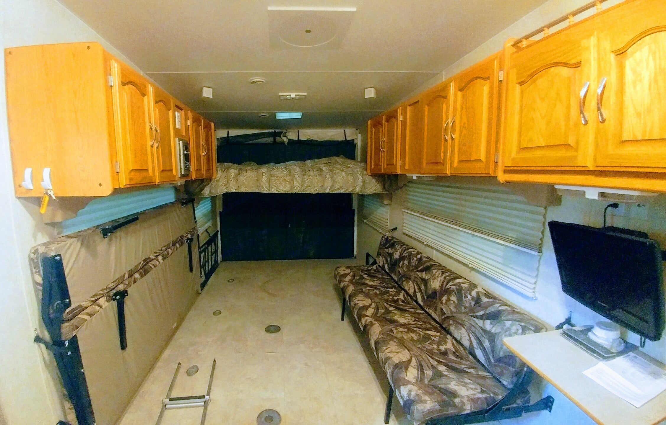 Both banquets fold into full beds. Forest River Sierra Sport 2004