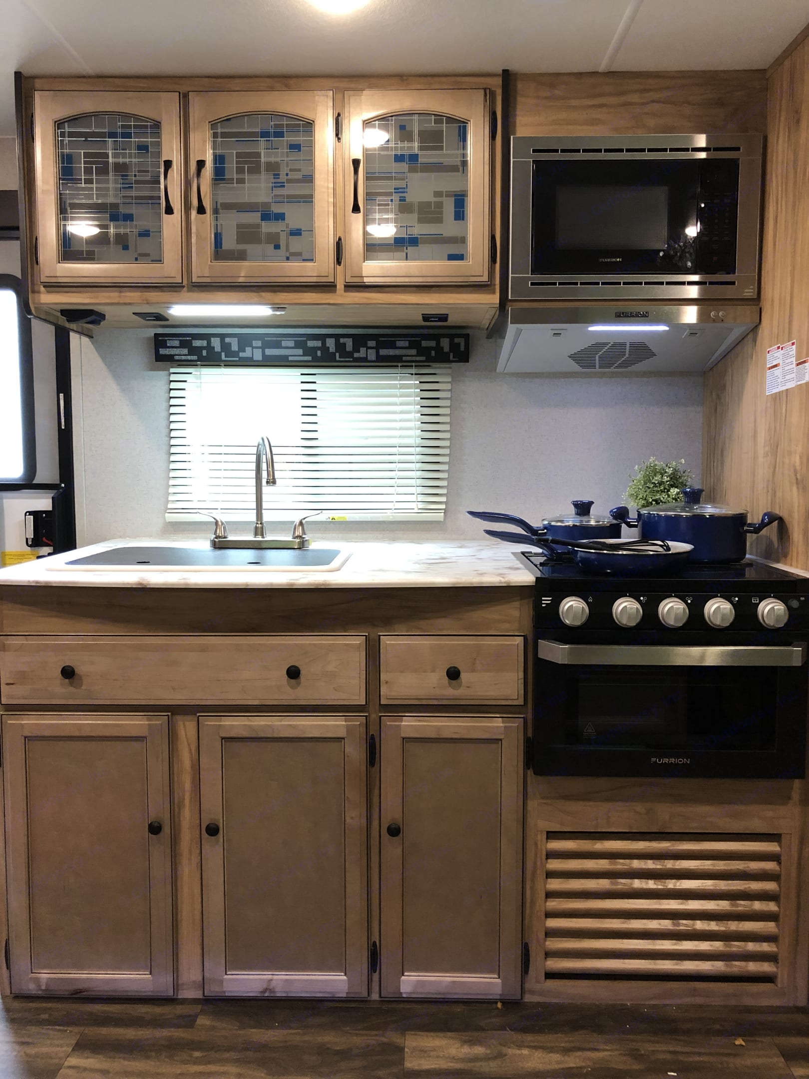 Large counter space with gas stove and oven. Coachmen Freedom Express 2019