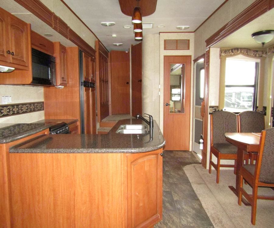 Never thought granite  kitchen space like this would come with a RV!. Heartland Big Country 2015